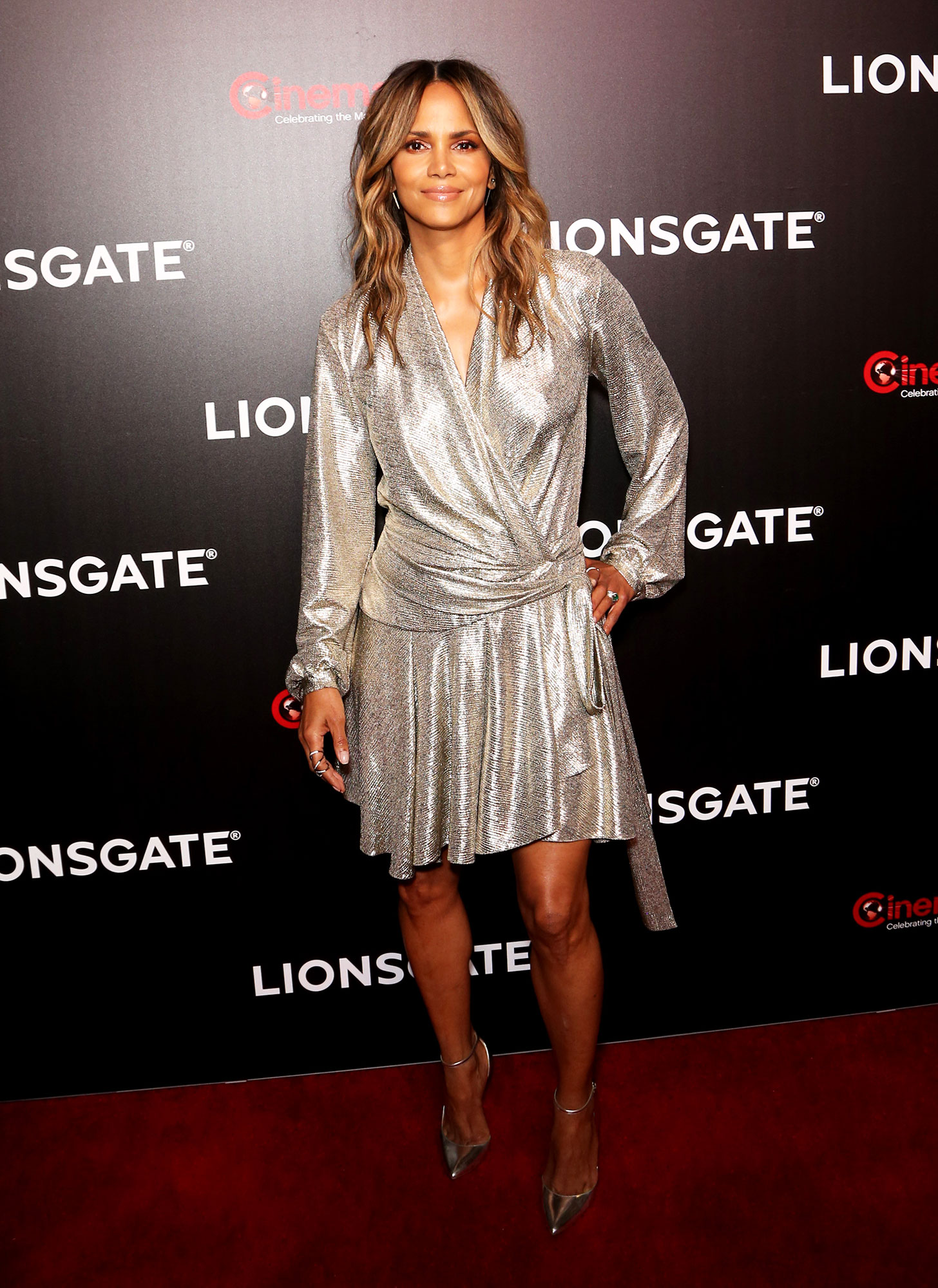 Halle Berry The Stars Are Bringing Their Style A-Game to CinemaCon - The Oscar-winner showed some leg in a Patbo platinum lamé mini wrap dress, Jimmy Choo pumps and Established, Graziela Gems and Vita Fede jewels on Thursday, April 4.