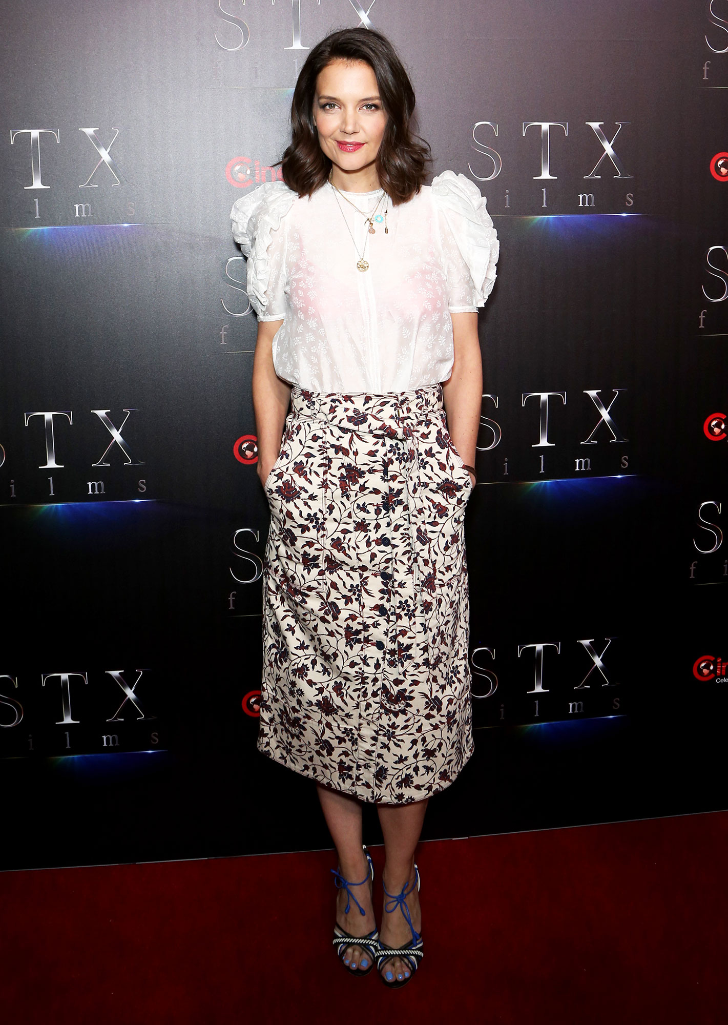 Katie Holmes The Stars Are Bringing Their Style A-Game to CinemaCon - Spring had sprung for the brunette beauty in a floral-print Ulla Johnson ensemble on Tuesday, April 2.