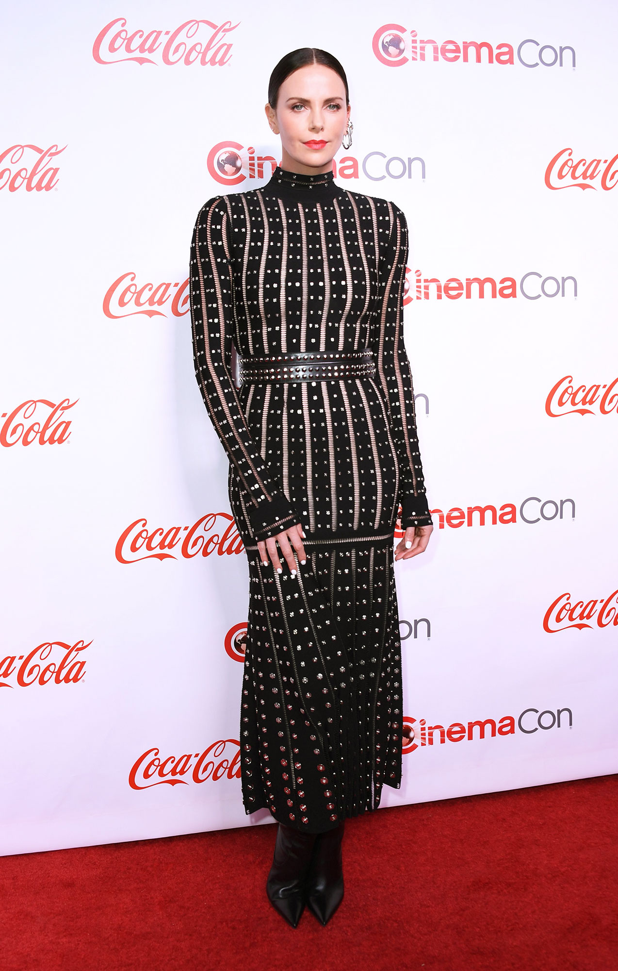 Charlize Theron The Stars Are Bringing Their Style A-Game to CinemaCon - The Long Shot actress stunned in a studded Alexander McQueen midi and Jimmy Choo boots on Thursday, April 4.