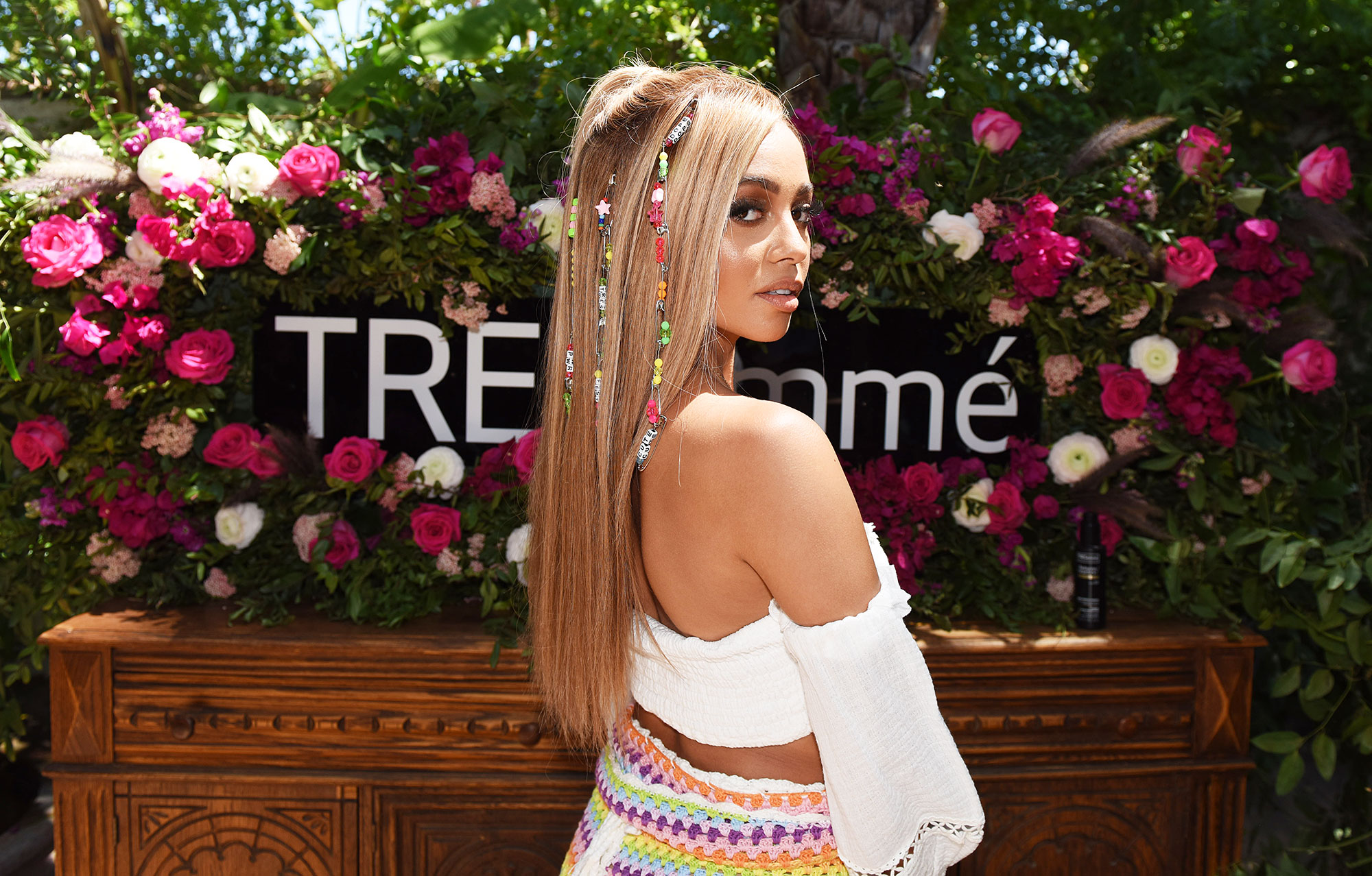 Vanessa Morgan Neon Beaded Half Up Ponytail TRESemme Coachella - The actress posed with her Neon Beaded Half-Up Ponytail at TRESemmé's #TRESfest Coachella event.