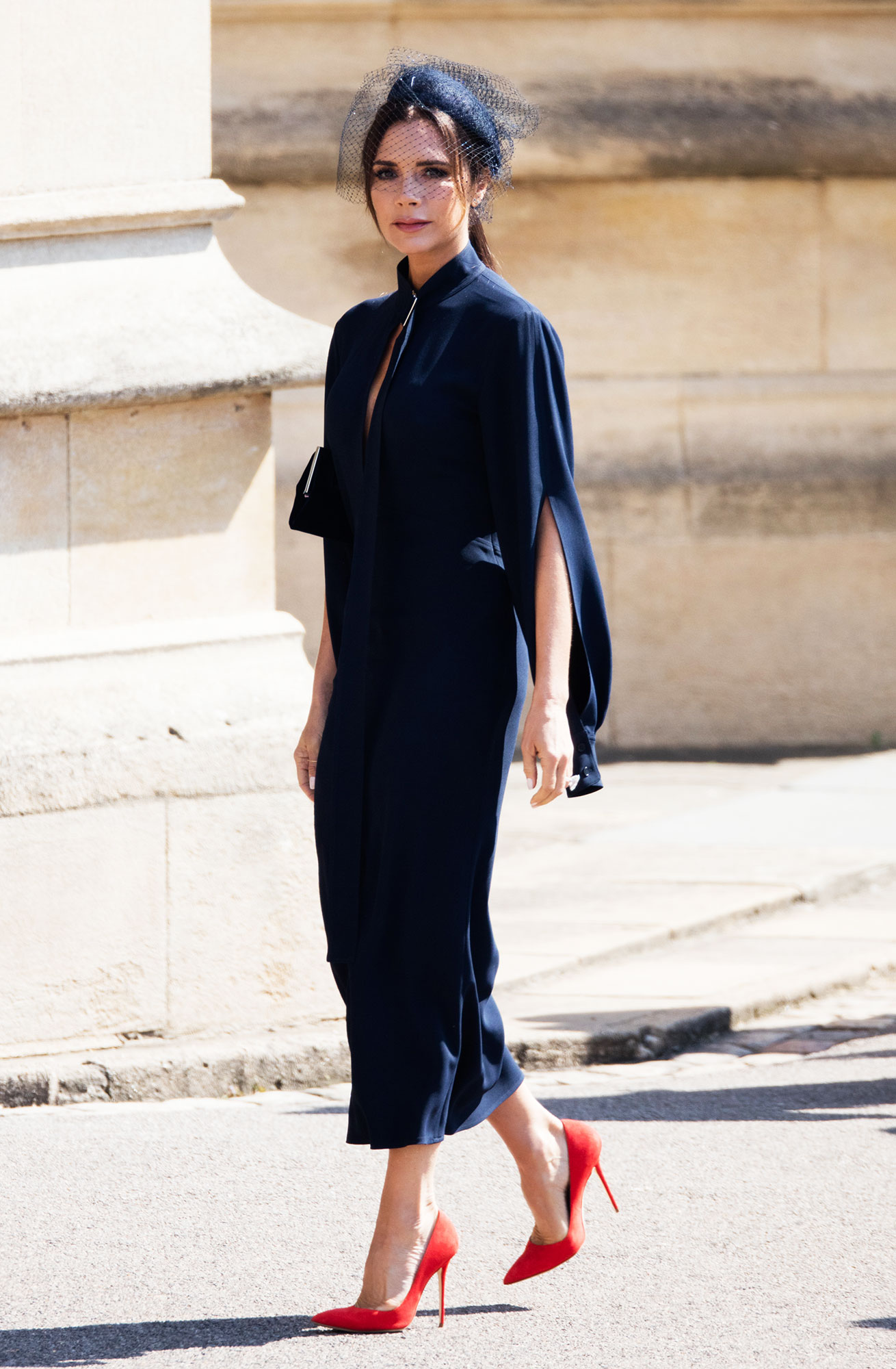 Victoria Beckham royal wedding orince harry meghan markle - The mom-of-four provided a bit of a #TBT moment in her navy blue Victoria Beckham mididress at Prince Harry and Meghan Markle's royal wedding on May 19, 2018. It was the same color she wore to watch Will and Kate tie the knot back in the 2011!