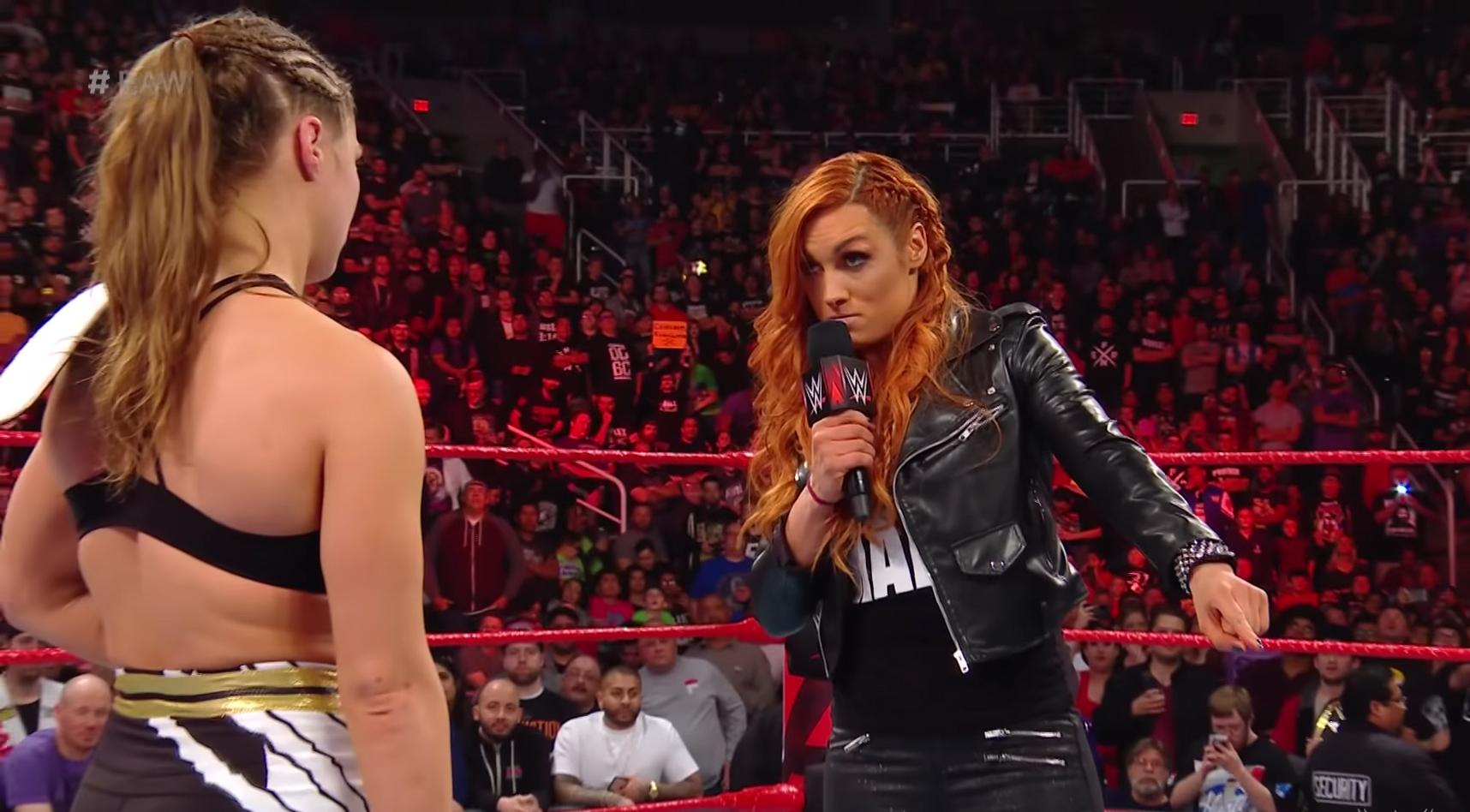 WWE Becky Lynch Slams Ronda Rousey - Becky Lynch and Ronda Rousey.