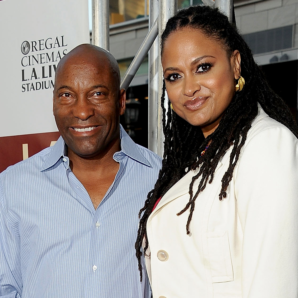 """ava-duvernay - DuVernay honored her fellow director with a sweet photo of the two sharing a hug on Twitter . """"There aren't many of us out here doing this. It's a small tribe in the grand scheme of things. He was a giant among us. Kind. Committed. And immensely talented. His films broke ground. His films mattered. He will be missed. And long remembered. Thank you, John. #RunIntoHisArms"""""""