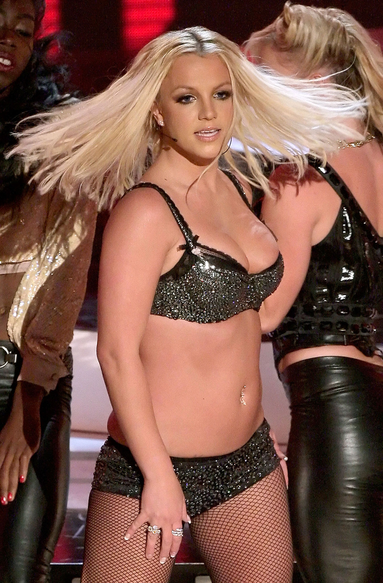 """Britney Spears' Ups and Downs gallery - After months of setbacks, Spears was criticized for her attempt at a comeback while performing """"Gimme More"""" at the 2007 VMAs."""