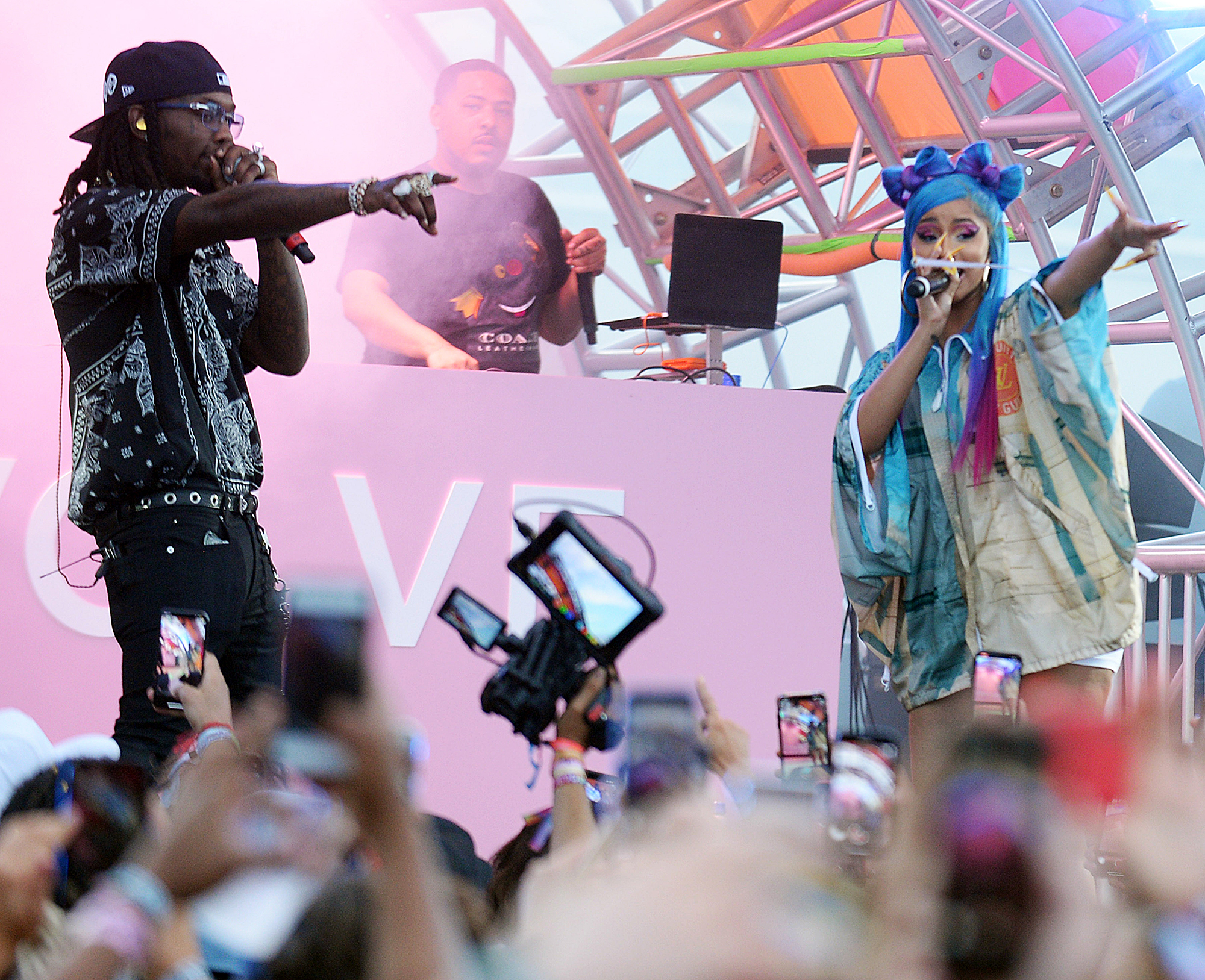 """cardi-b-offset-coachella-pda - Cardi made her first surprise appearance at Coachella on Friday, April 12, joining Selena Gomez, DJ Snake and Ozuna to perform their single, """"Taki Taki,"""" during the DJ's set."""