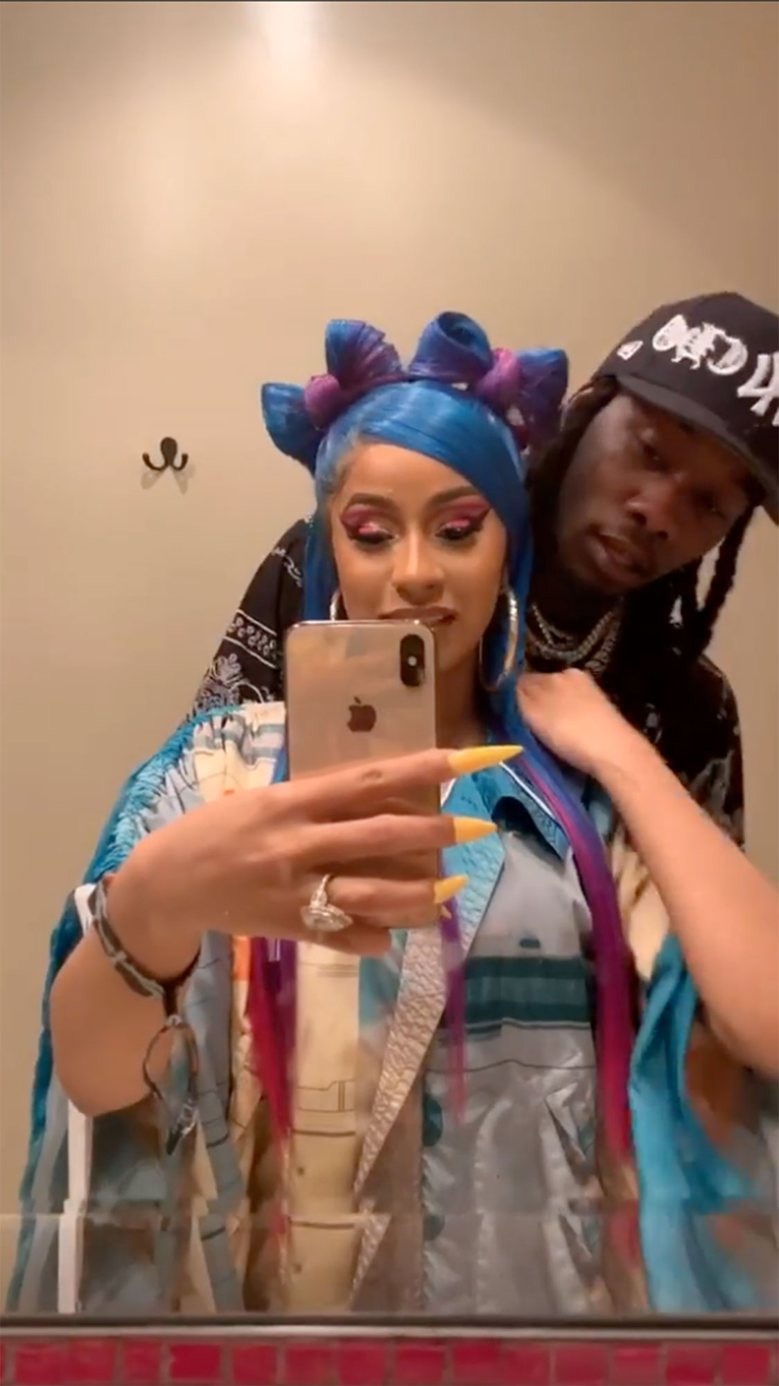 "Cardi B coachella offset - The "" Money "" rapper admired her own Coachella-ready, multi-colored locks in a mirror before husband Offset swooped in to shower her with kisses at the Revolve Festival, where she joined him on stage."