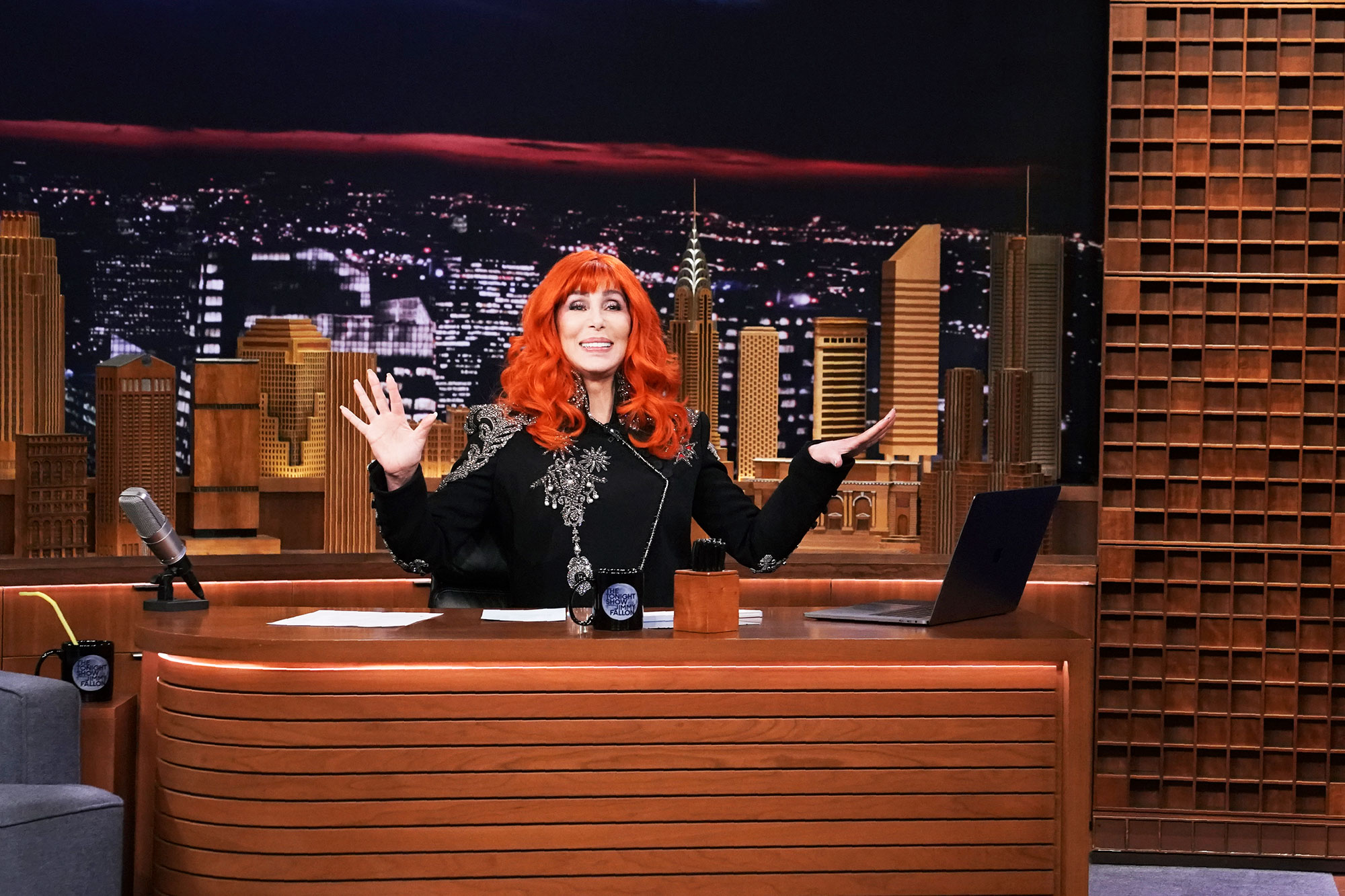 Cher Go Bold in Brightly Colored Wigs - Typically known for her raven-black hair, the music legend took over The Tonight Show Starring Jimmy Fallon on April 15 wearing a orange-red wig with short fringe.