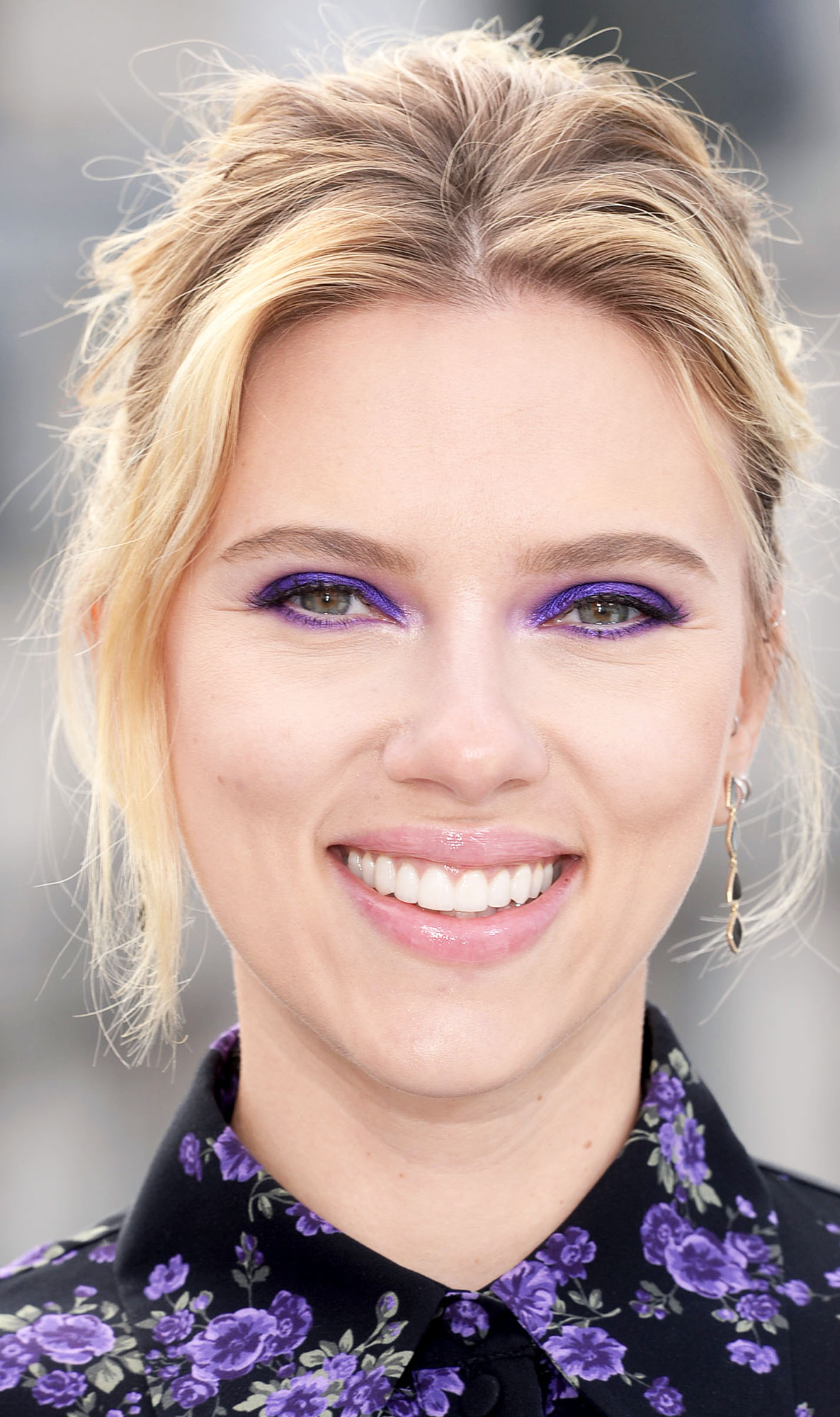 Scarlett Johansson coachella makeup purple eyeshadow - Makeup artist Frankie Boyd made the case for matching your makeup to your wardrobe with this violet eye for the Avengers Endgame star that picked up the pretty floral pattern of her Michael Kors frock at a photocall for the film in London on Thursday, April 11.