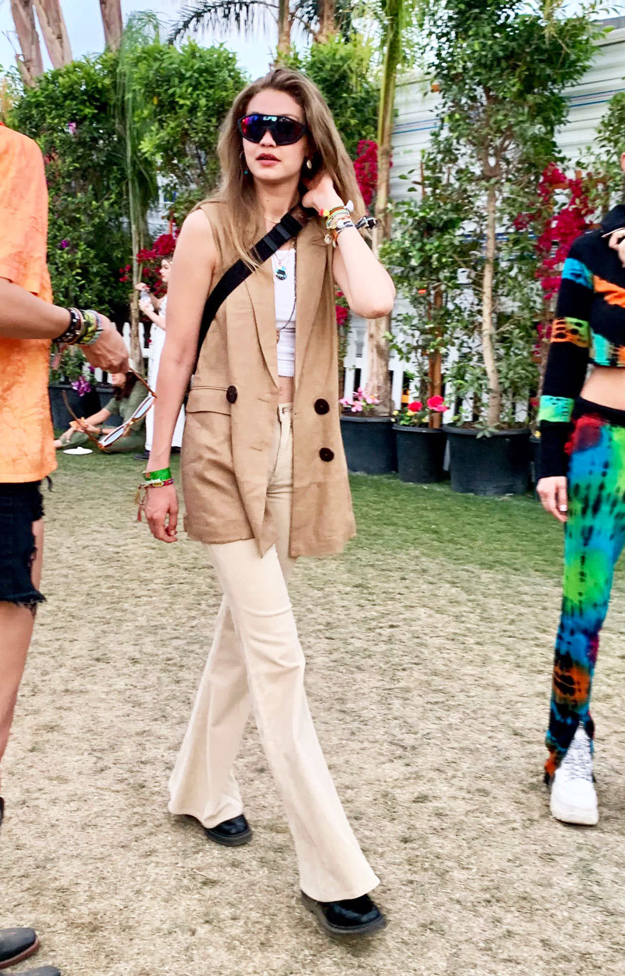 coachella fashion Gigi Hadid - The model opted for a neutral color palette in her flared khakis and suede vest on Sunday, April 14.
