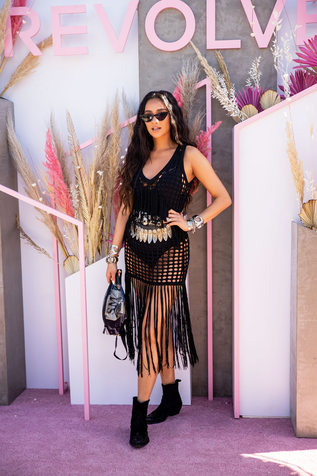 Shay Mitchell coachella fashion - Crochet and fringe made the perfect pair on the You star's sheer dress at the Revolve Festival on Saturday, April 13. She accessorized with the new belt bag from her BEIS collection and Golden Goose booties.