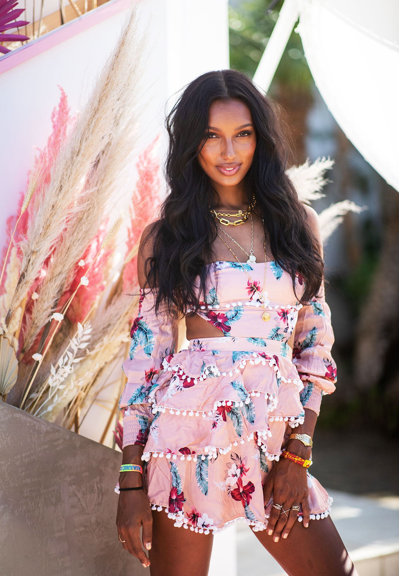 Jasmine Tookes coachella fashion - Ruffles and pom-poms upped the flirty factor of the model's flowery mini at the Revolve Festival on Saturday, April 13.