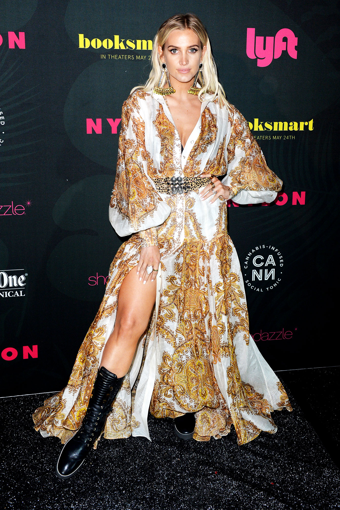 Ashlee Simpson coachella fashion - Paying homage to 2018 festival season's combat boots-trend, the songstress paired hers with a voluminous gold-printed Zimmermann maxi at the NYLON Midnight Garden Party on Friday, April 12.
