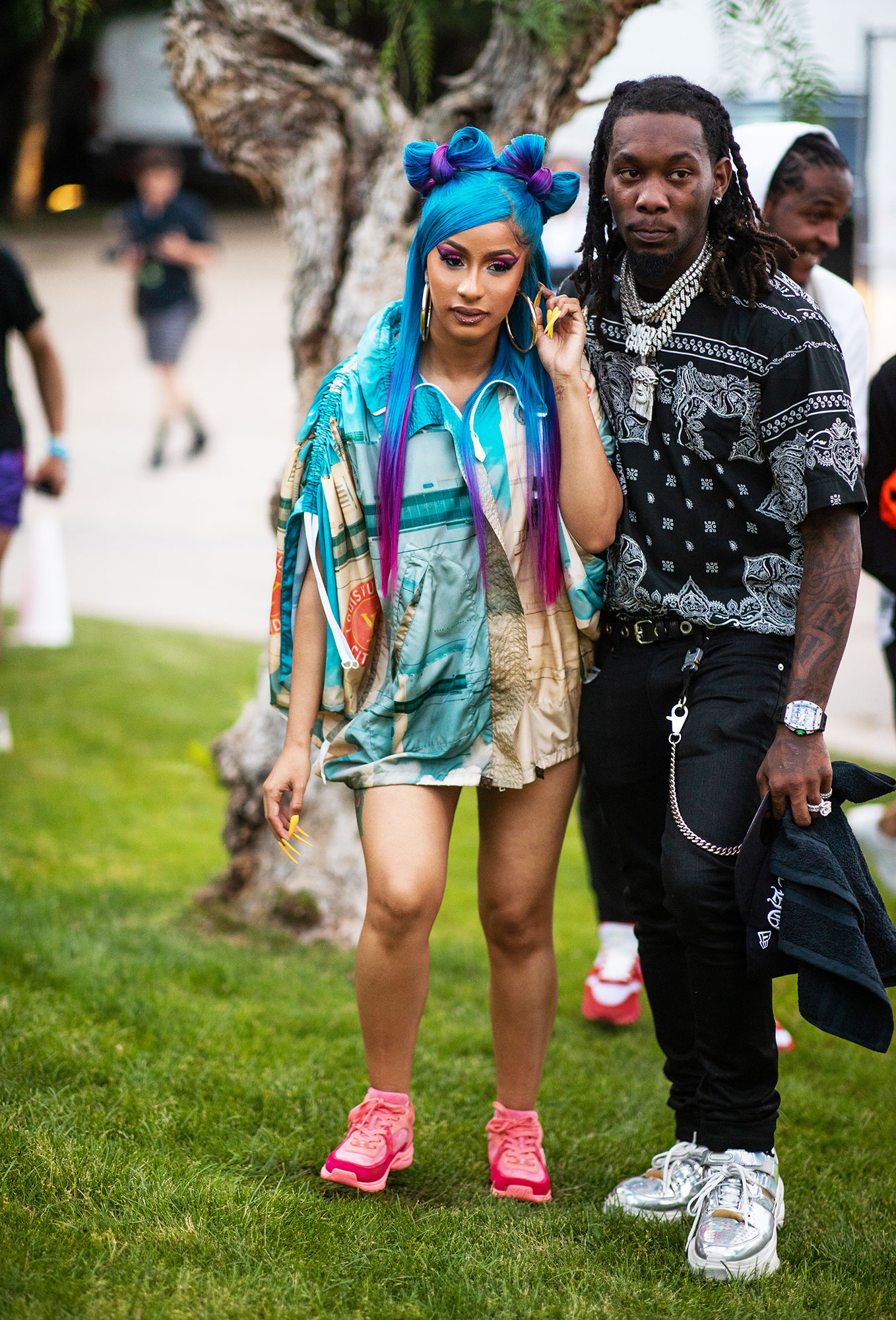 Cardi B and Offset coachella fashion - After slaying her performance on Saturday night, the rapper rocked rainbow strands with her printed minidress at the Revolve Festival on Sunday, April 14.