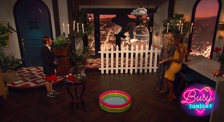 "Colton Underwood Reenacted Fence-Jumping Scene Busy Tonight - Colton Underwood recreates fence-jumping scene on ""Busy Tonight""."