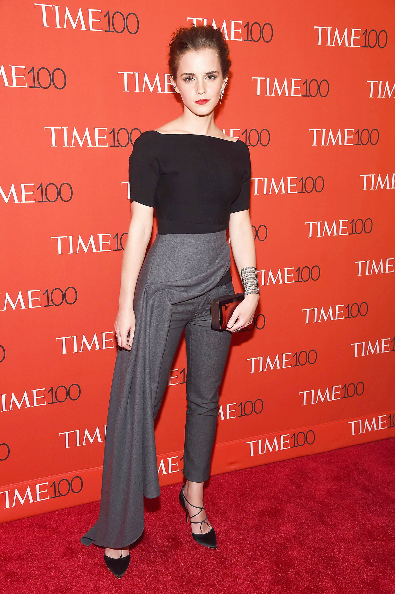 Emma Watson birthday red carpet outfits - She wears the pants! The actress sported a Dior jumpsuit with lace-up Rupert Sanderson pumps and a Rauwolf clutch at the Time 100 Gala in NYC.
