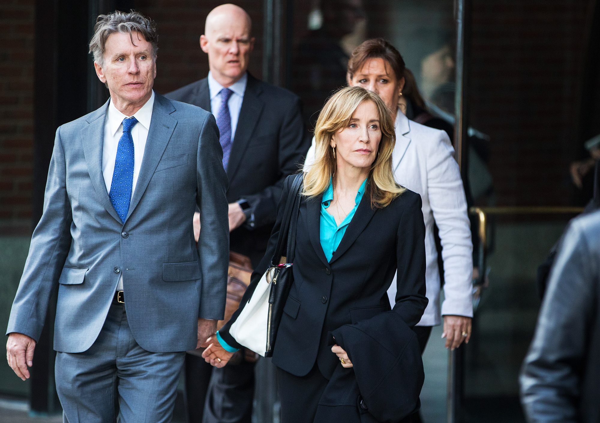 felicity-huffman-court - The Desperate Housewives alum arrived at the same courthouse on April 3, 2019, in a black peacoat, a black blazer, matching slacks and a turquoise blouse. Her husband, William H. Macy, was not present.