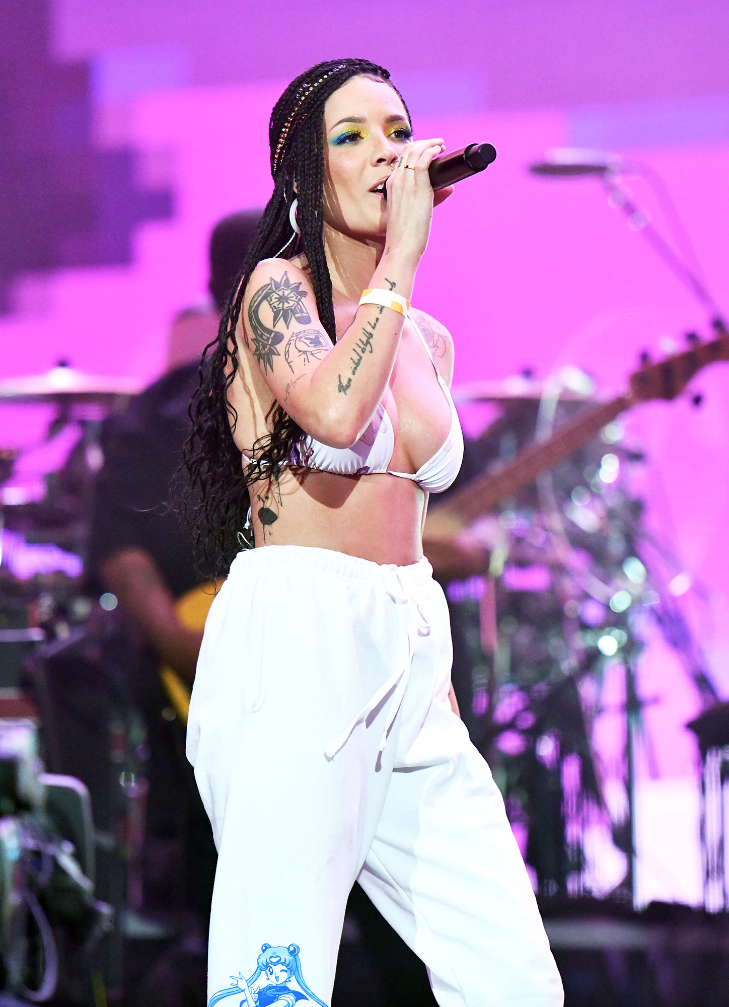 halsey coachella 2019 hair makeup beauty - The performer's multi-colored eye makeup was a major standout. Using the yellow and lime green shades from NYX Professional Makeup's Ultimate Shadow Palette , makeup artist Denika Bedrossian faded these into a two-tone blue by blending them out to create a gradation of color.