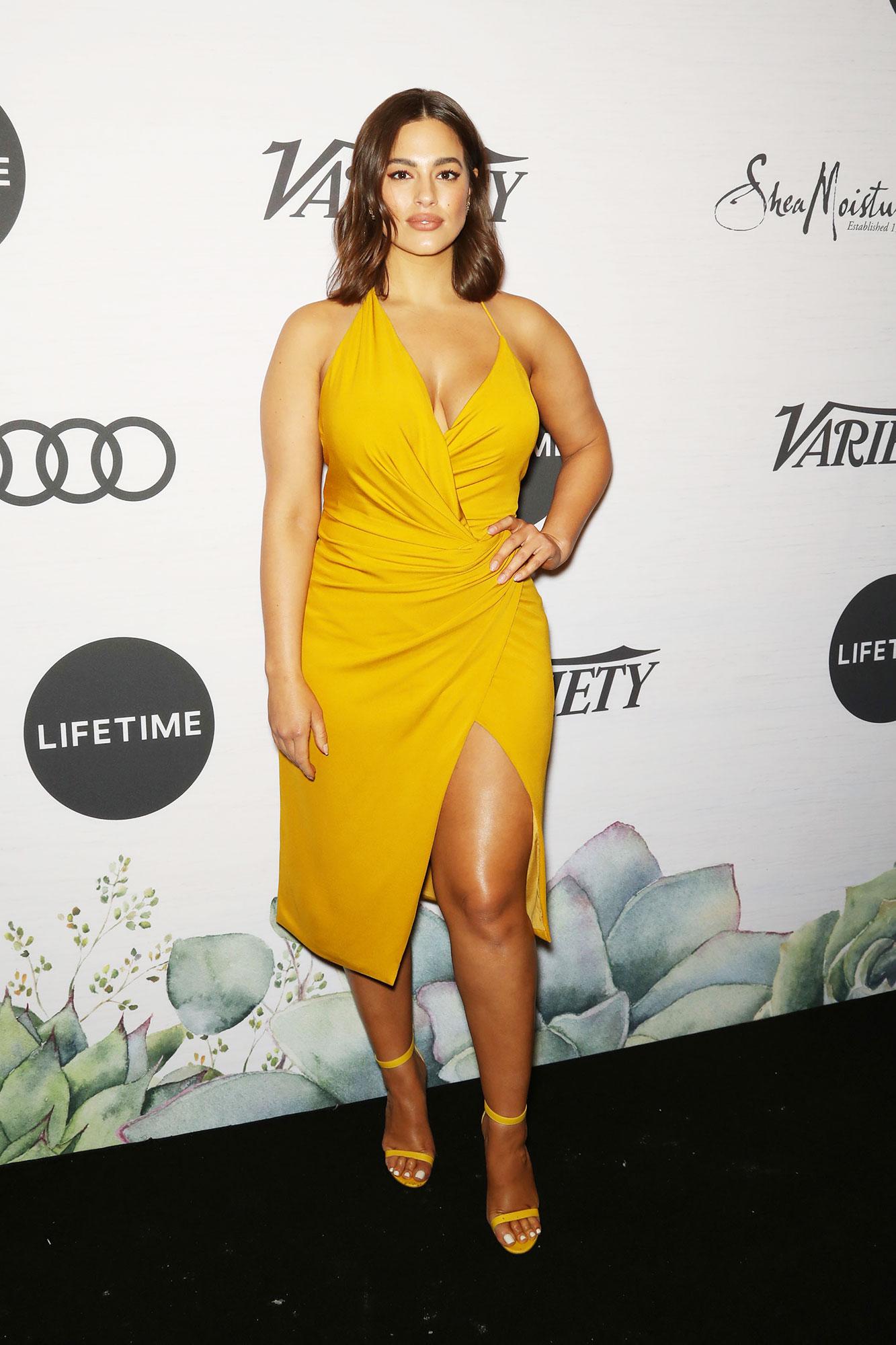 Ashley Graham Variety's Power of Women - The supermodel dazzled in a mustard yellow asymmetrical slip dress.