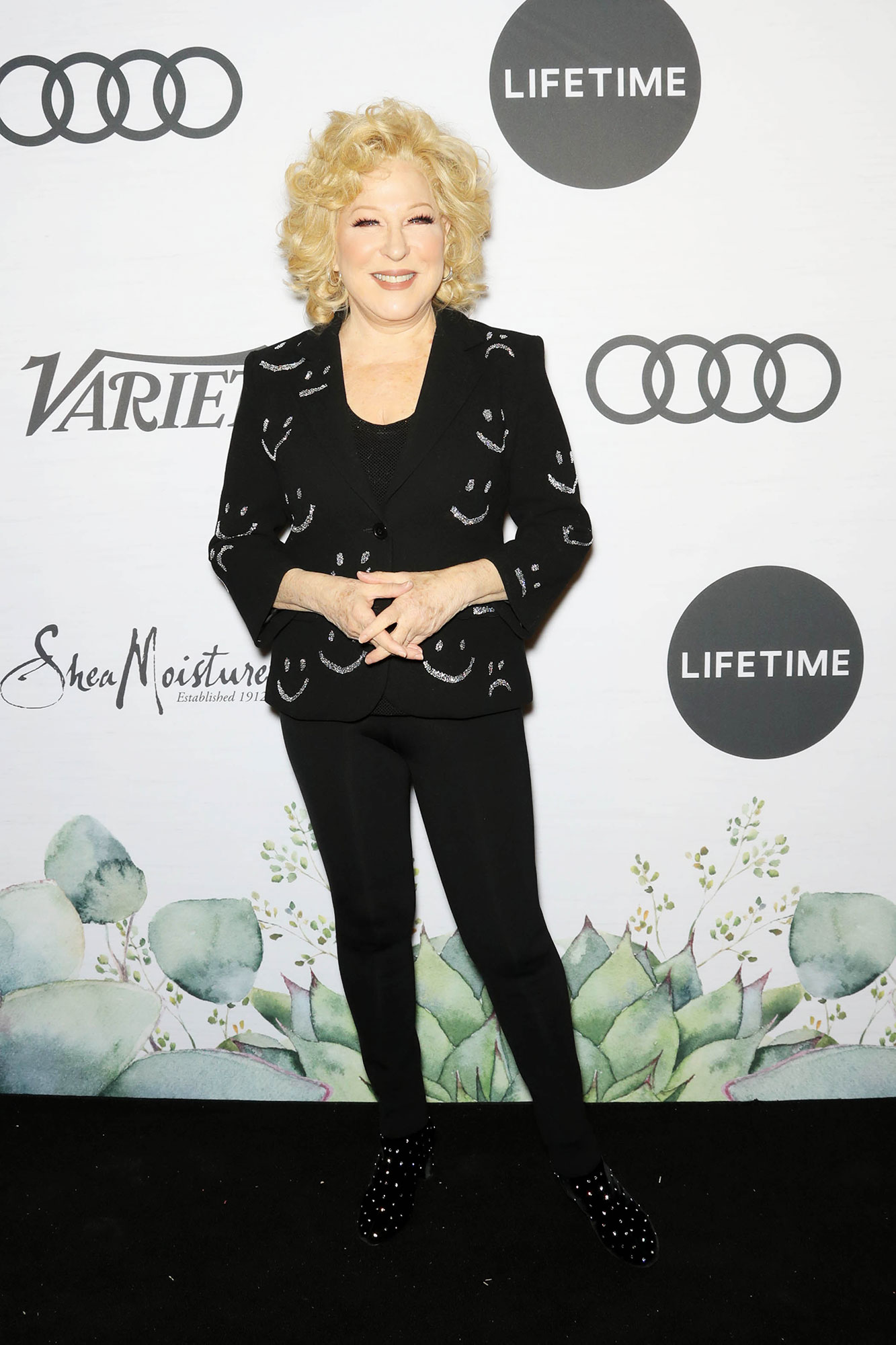Bette Midler Variety's Power of Women - The Broadway star wore an all-black pantsuit with little silver smiley faces printed on the jacket.