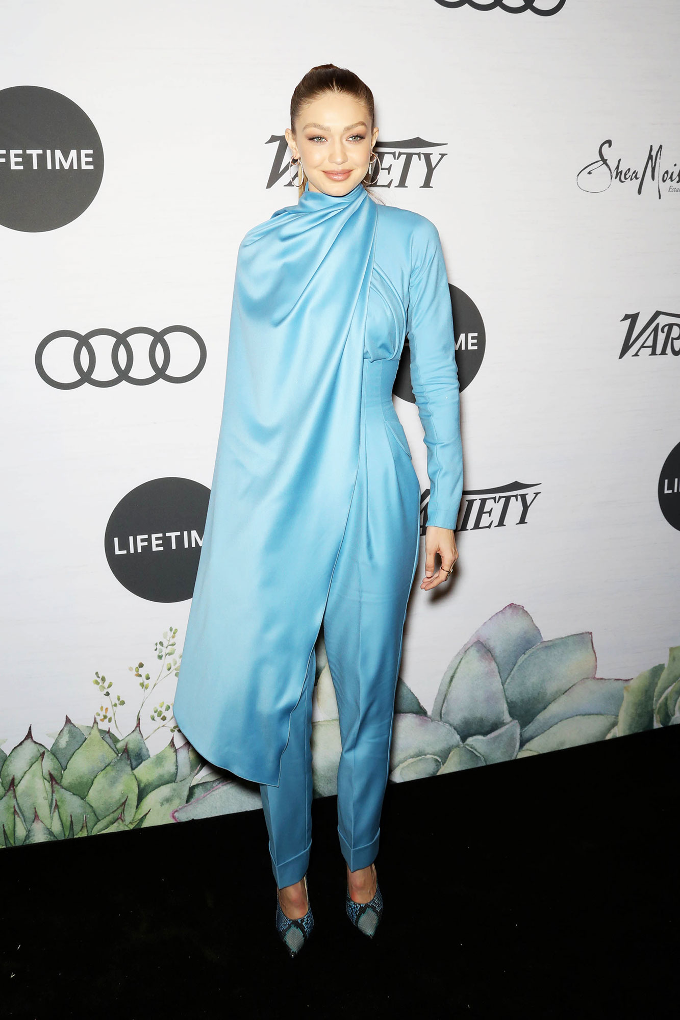 Gigi Hadid Variety's Power of Women - The blonde beauty wore a sky-blue cape-neck top with matching high-waisted trousers from Emilia Wickstead and Chopard jewelry.