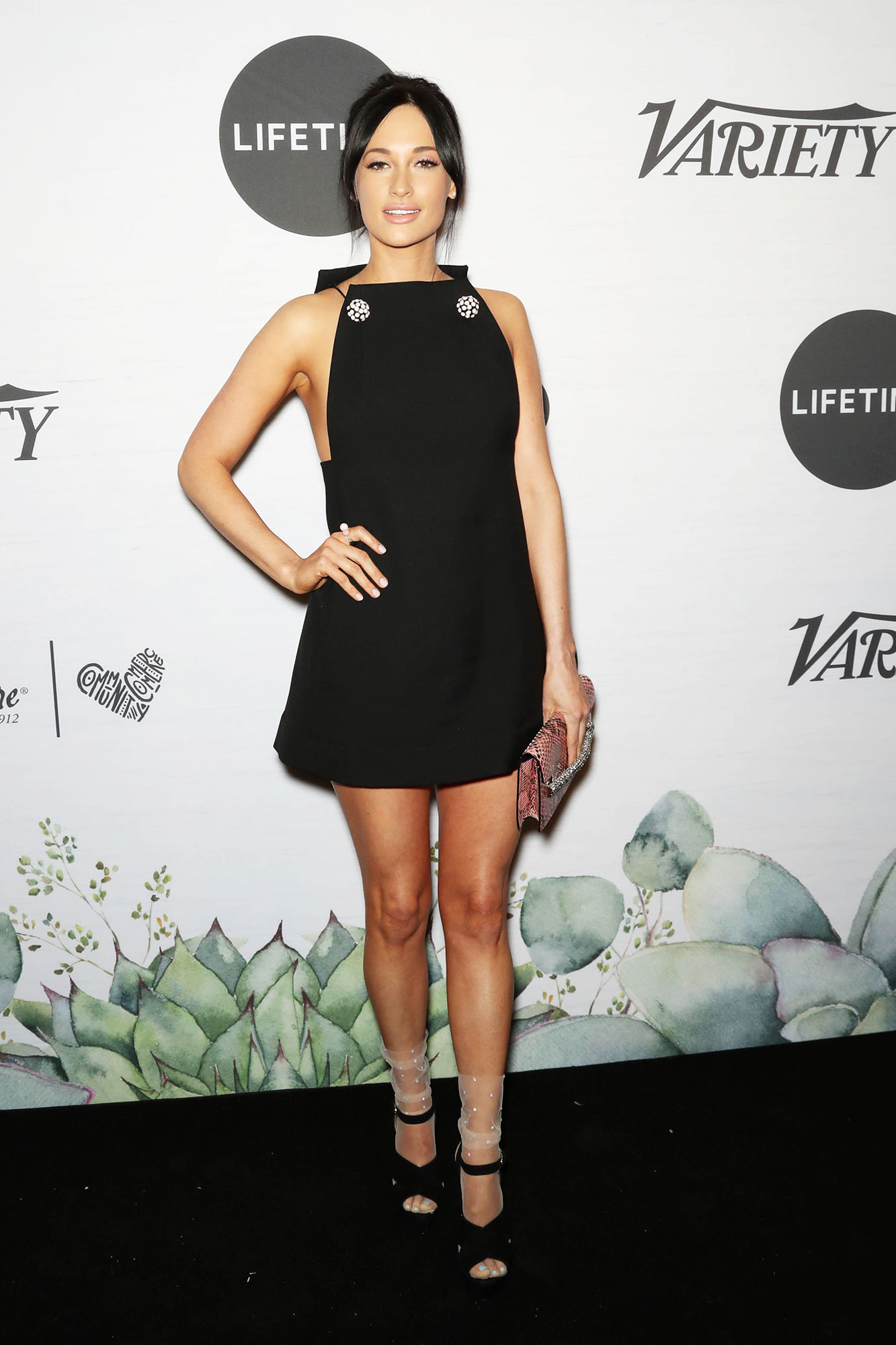 Kacey Musgraves Variety's Power of Women - Proving herself a style icon, the Grammy-winner wore a black minidress with two silver embellished broaches and sheer socks underneath her chunky open-toe heels.