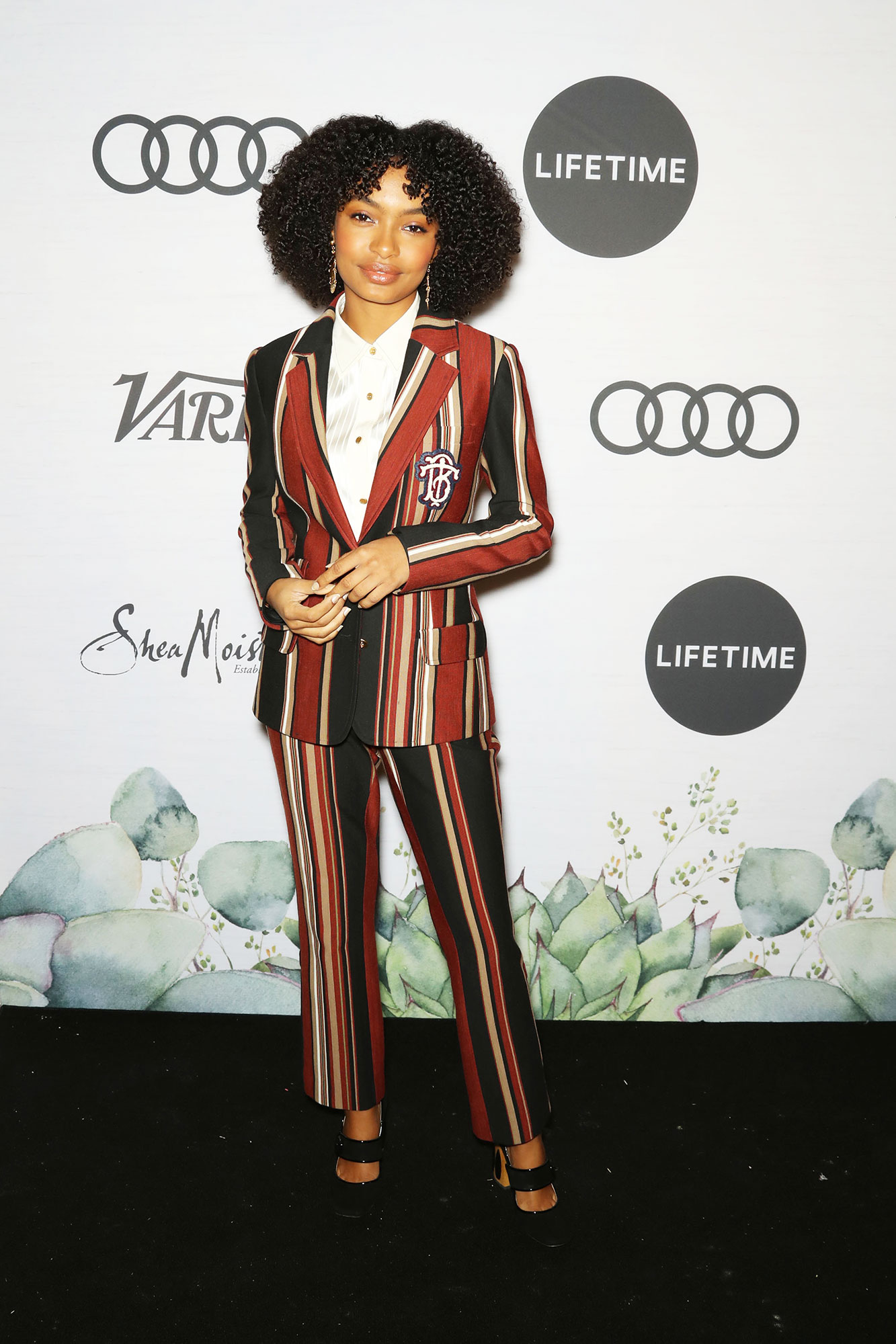 Yara Shahidi Variety's Power of Women - Looking as adorable as ever, the Blackish actress wore a sleekly tailored suit with earthy multicolored stripes.