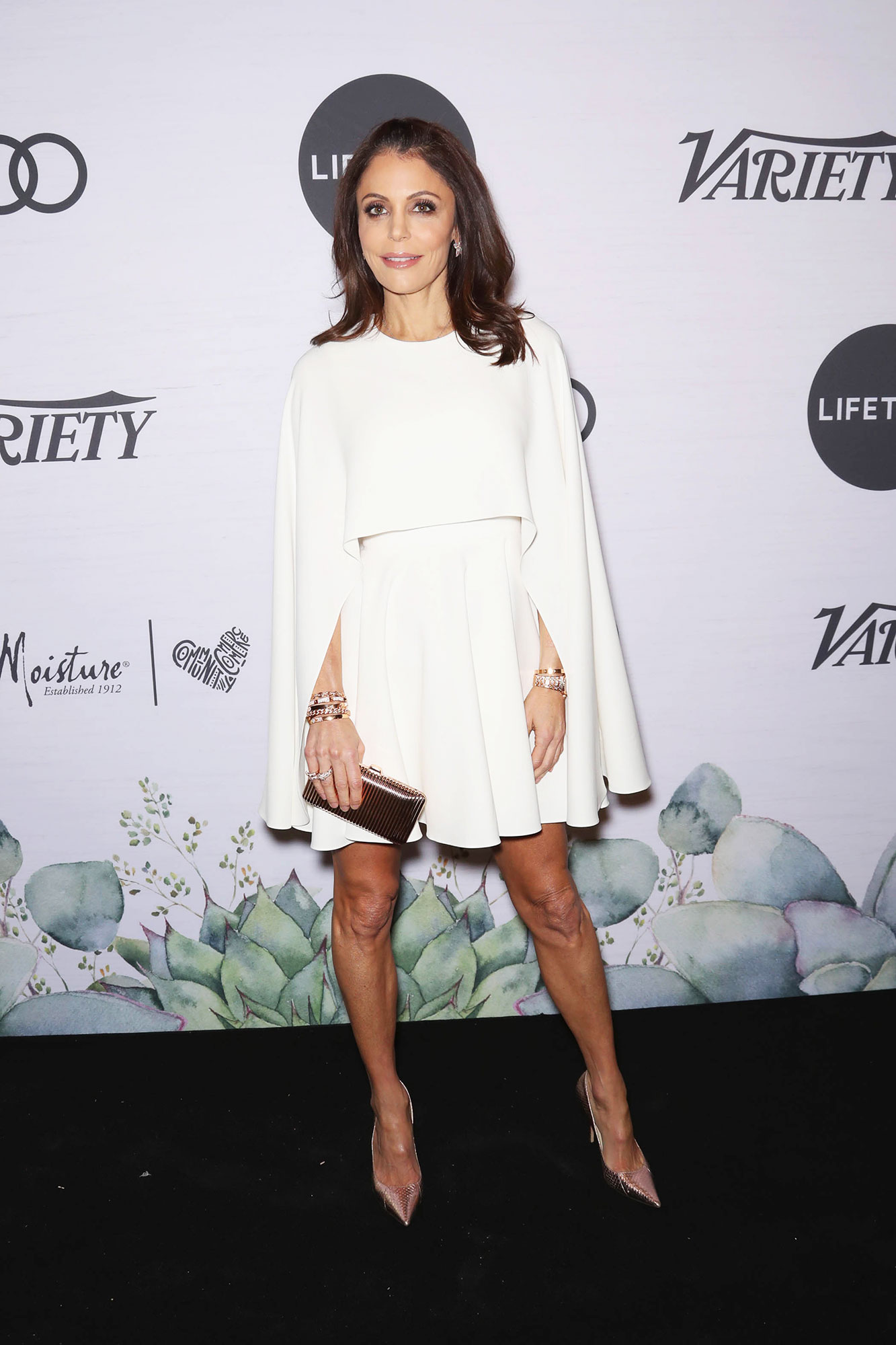 Bethenny Frankel Variety's Power of Women - The reality star wore a white minidress with cape sleeves and a pleated skirt.