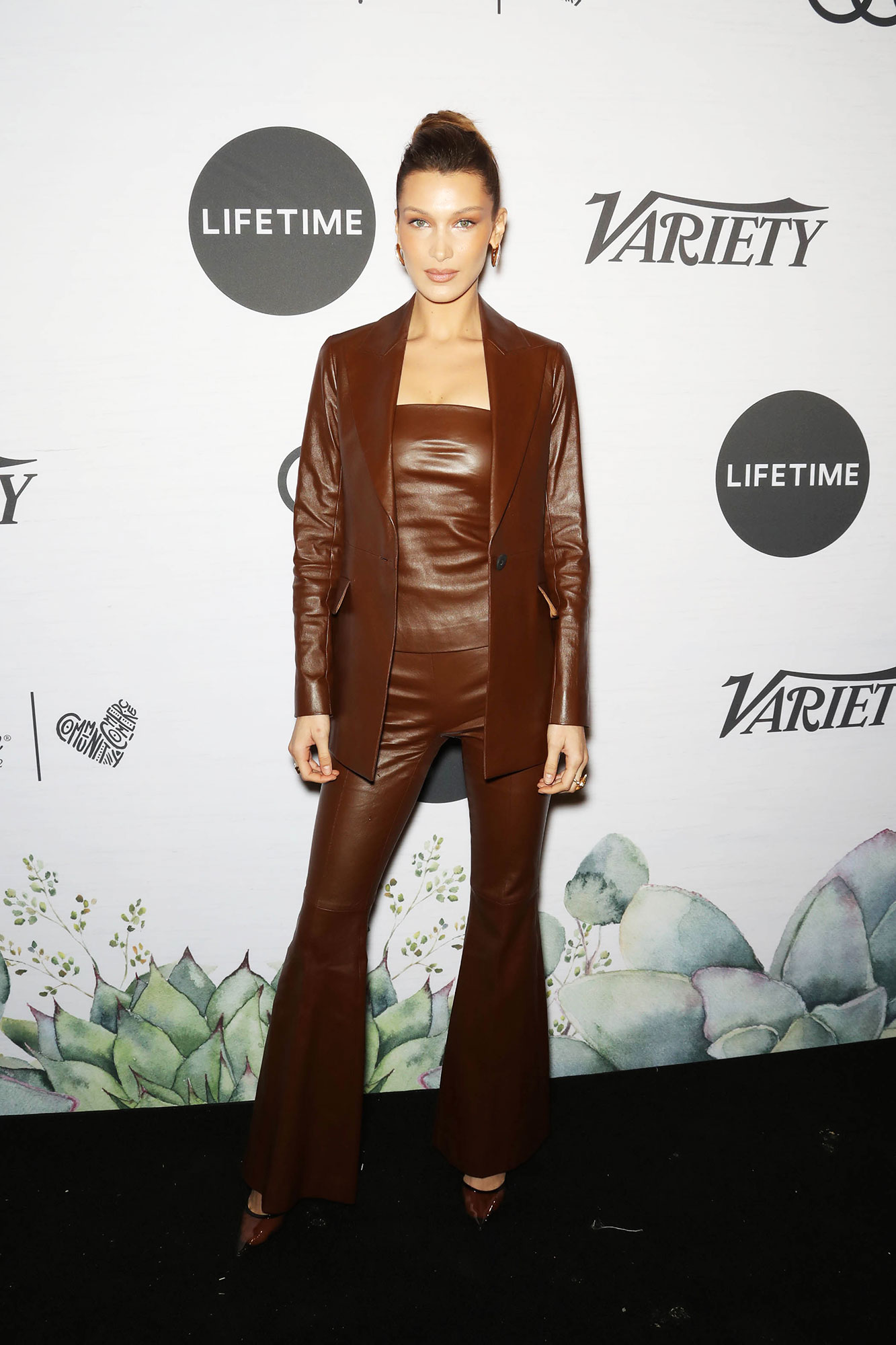 Bella Hadid Variety's Power of Women - Arm-in-arm with her sister, the younger Hadid rocked a brown leather look complete with a matching tube top, blazer and flared pants.