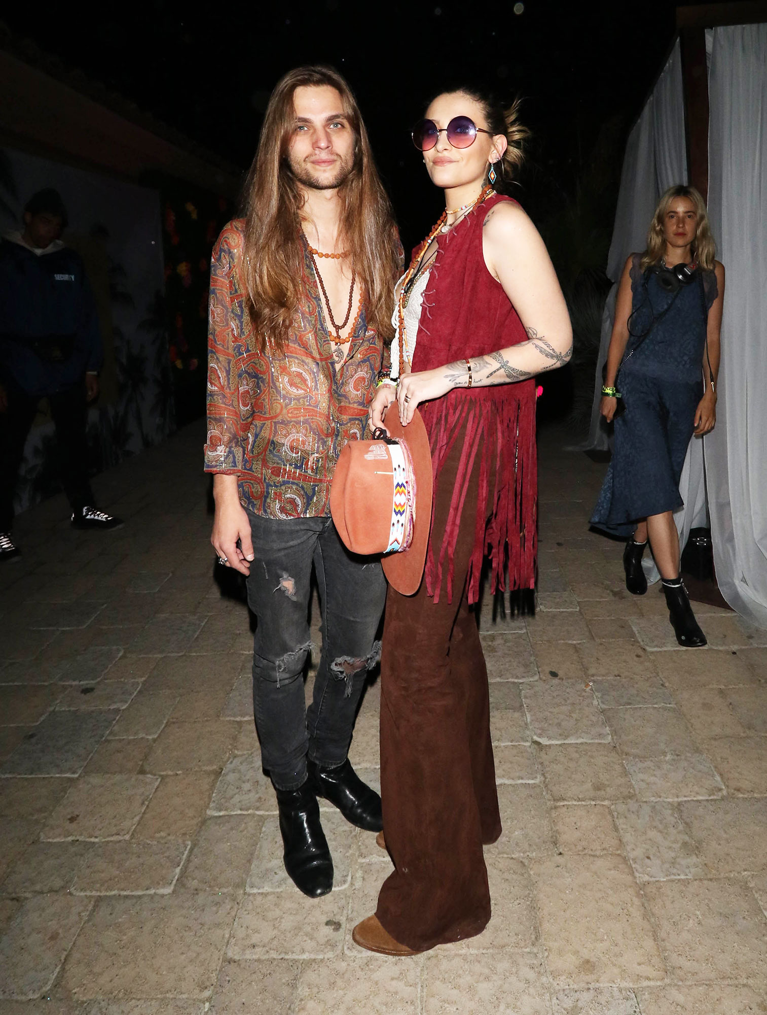 paris jackson 2019 Coachella Valley Music & Arts Festival - The Star actress and her beau opted for boho vibes on April 14, with Glenn in a sheer printed paisley blouse and gray denim and Jackson sporting a red fringe vest, a tan hat with a colorful band and flared brown pants.