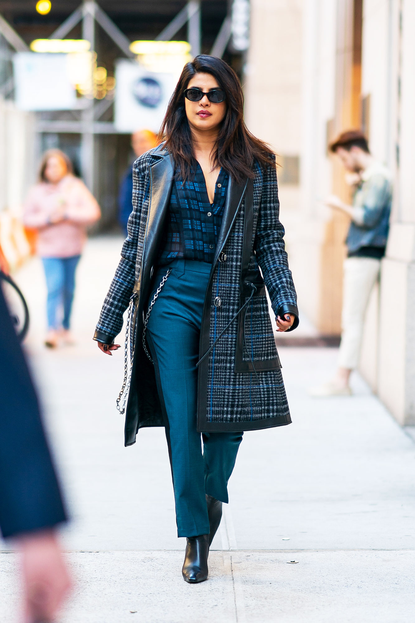 Priyanka Chopra blue plaid trench plaid shirt blue trousers pants - Showing Us how to transition our winter wardrobe to spring, the former Quantico actress sported a plaid Coach coat and Roberi & Fraud shades in NYC.