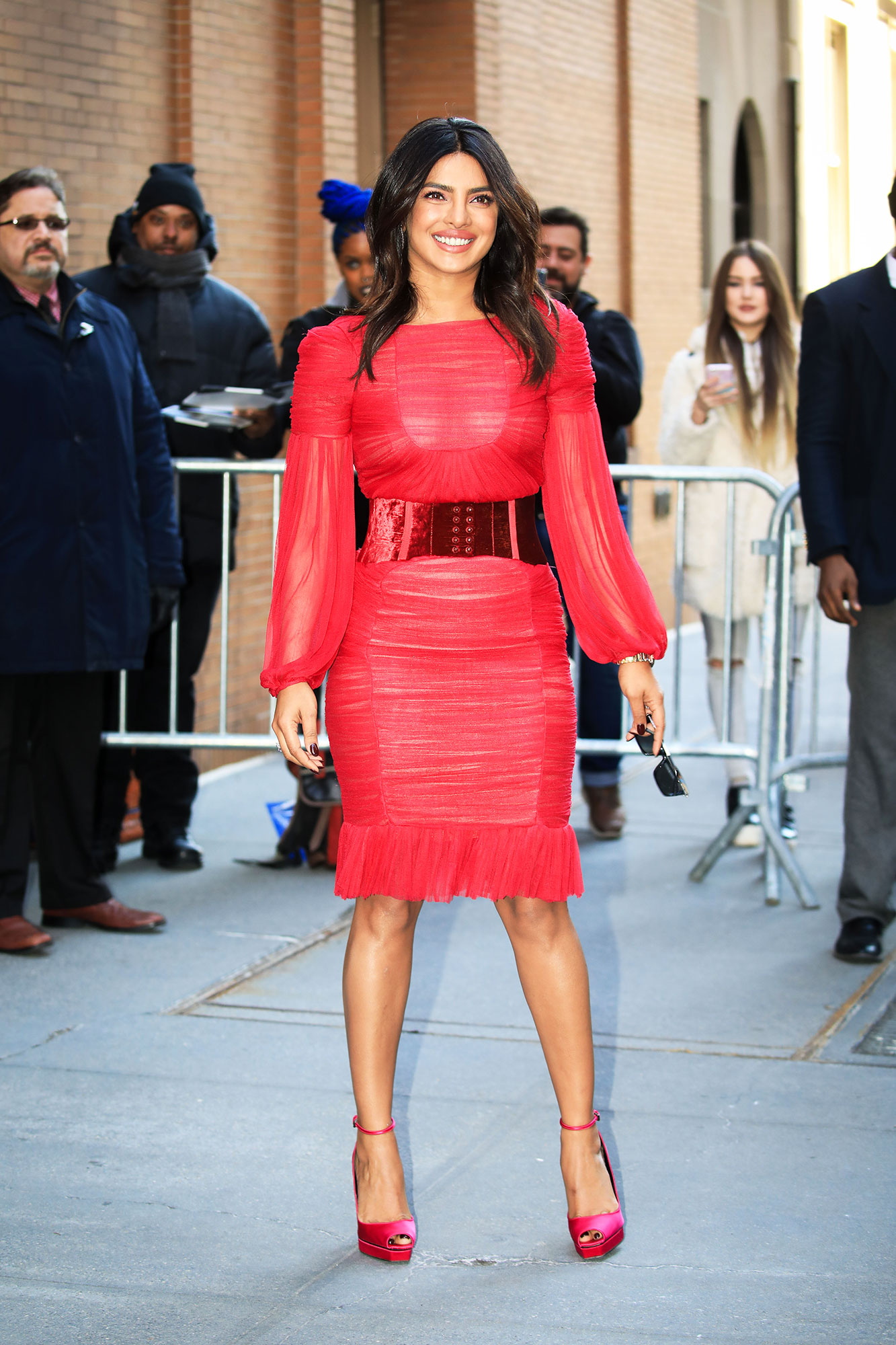 Priyanka Chopra pink red dress new york city - Red hot! The actress rocked a Vintage Tom Ford ruched minidress and Chopard jewels for an appearance on The View .