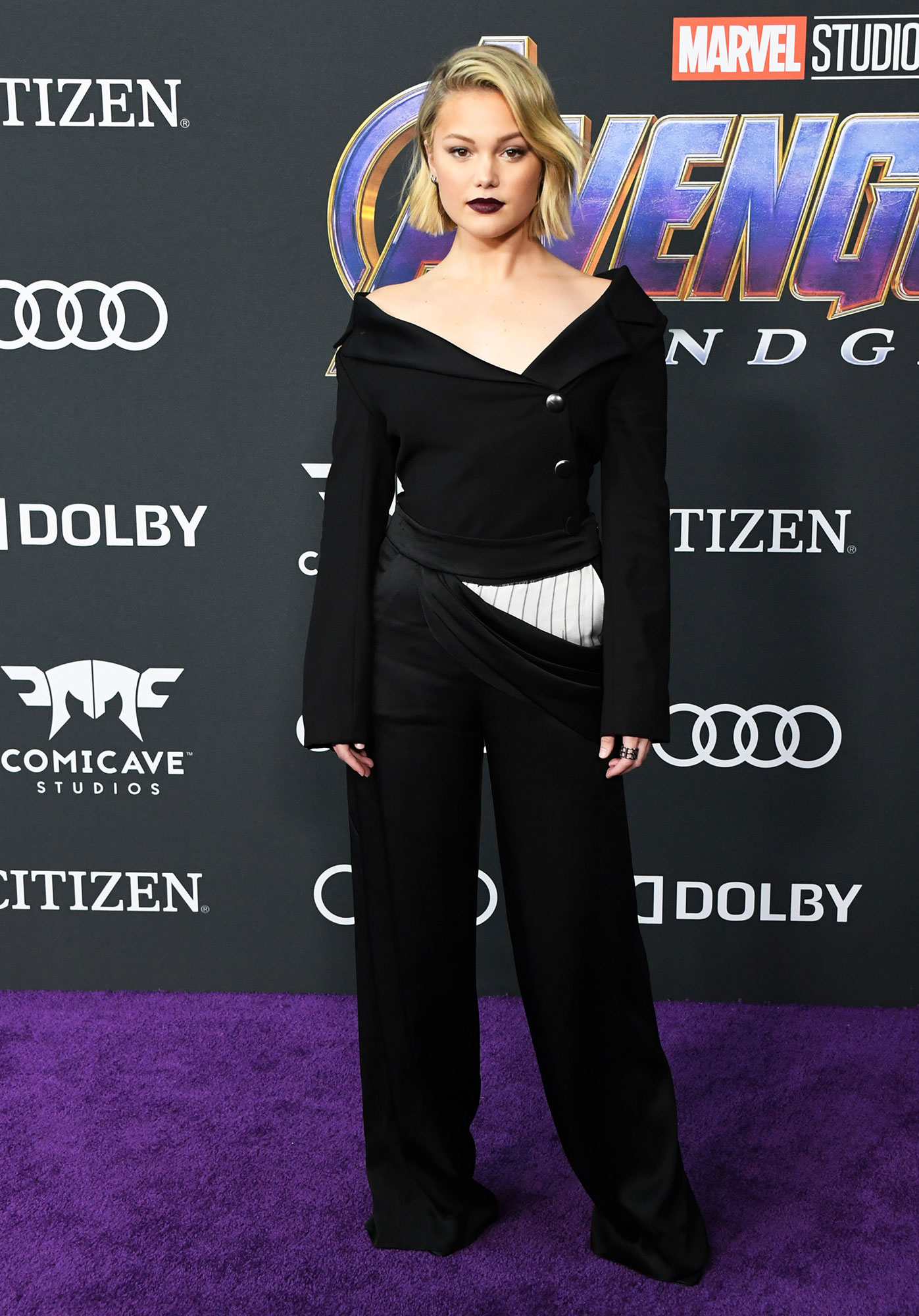 Olivia Holt Avengers Premiere - Wearing an off-the-shoulder Monse suit with Vince Camuto shoes and Rachel Katz and Graziela Gems jewels.