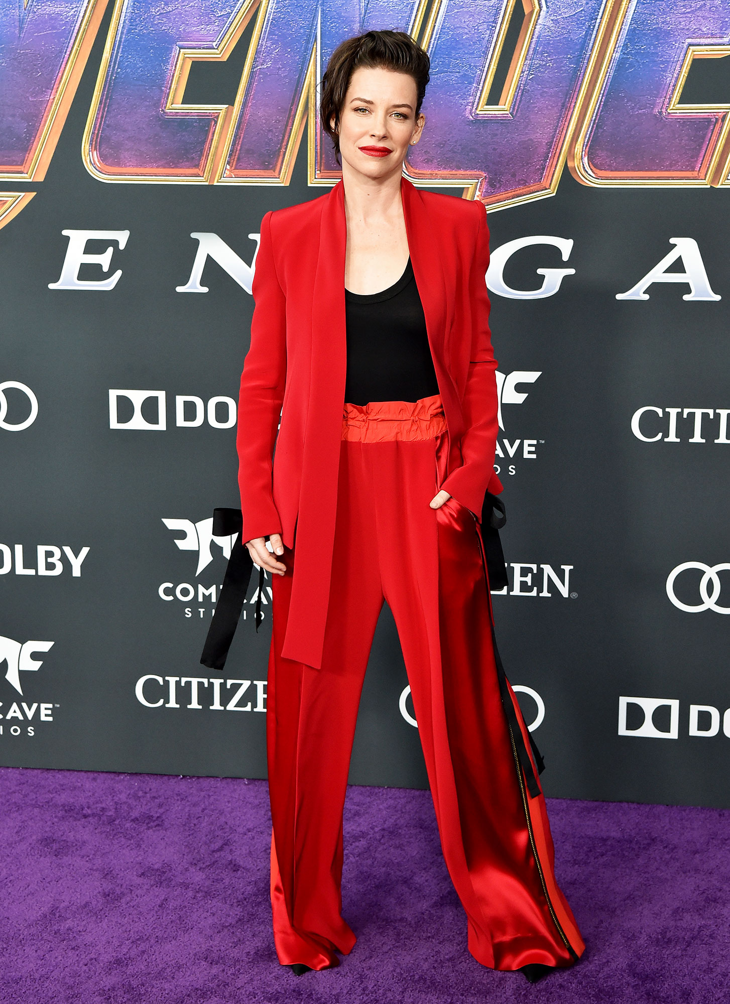 Evangeline Lilly Avengers Premiere - Wearing a scarlet Denis Gagnon suit and matching lip.