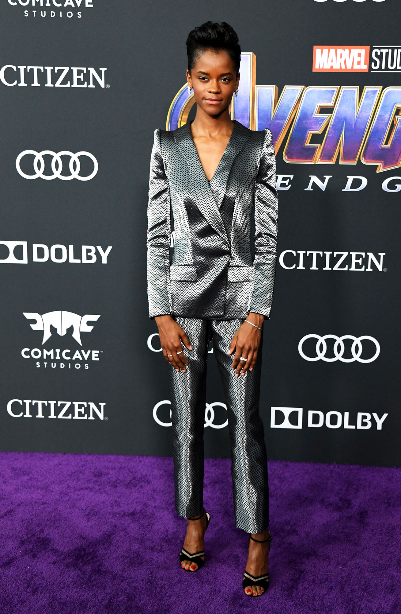 Letitia Wright Avengers Premiere - Wearing a metallic Armani suit and Cartier jewels.