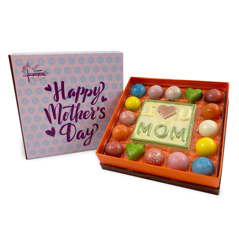 """""""I Love You Mom"""" Bonbon Box Mother's Day Gifts for the Foodie in Your Life - Offering a mouth-watering twist on his original bonbon box, Jacques Torres' limited-edition Mother's Day bonbon arrangement includes a combination of four new flavors: rose champagne to celebrate her, rose petals to honor her and bring a bit of nostalgia, soft mint as a refresher and tropical colada to give her a brief escape to paradise."""