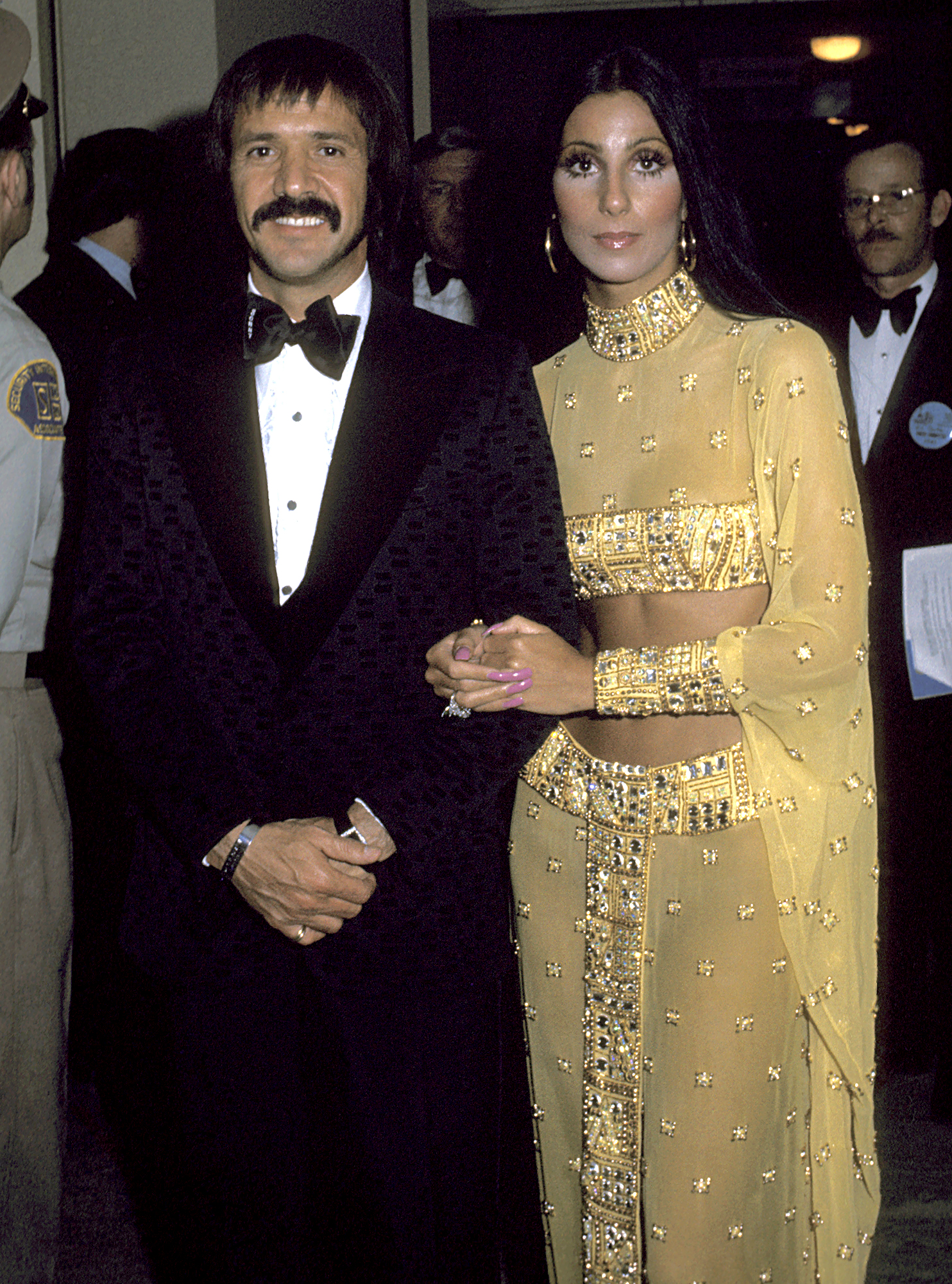 1973-Cher - With then-husband Sonny Bono at the 45th annual Oscars, Cher wore one of her most iconic looks designed by Bob Mackie — a sheer gold jewel gown that showed off her entire midriff.