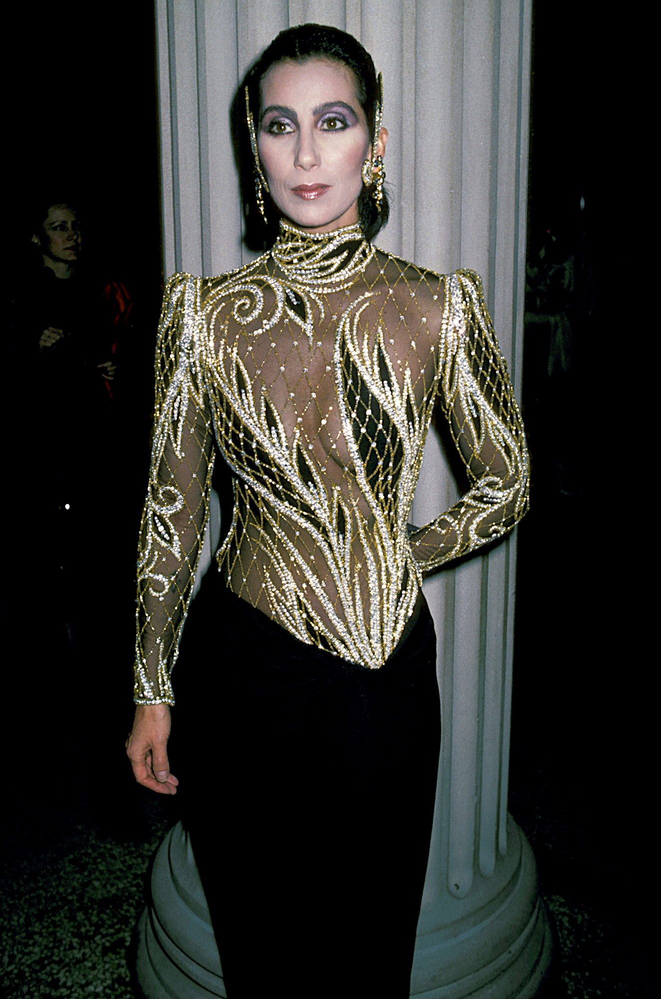 """1983-Cher - In a Bob Mackie gown, the """"I Got You Babe"""" singer wowed at the Diana Vreeland costume exhibit."""