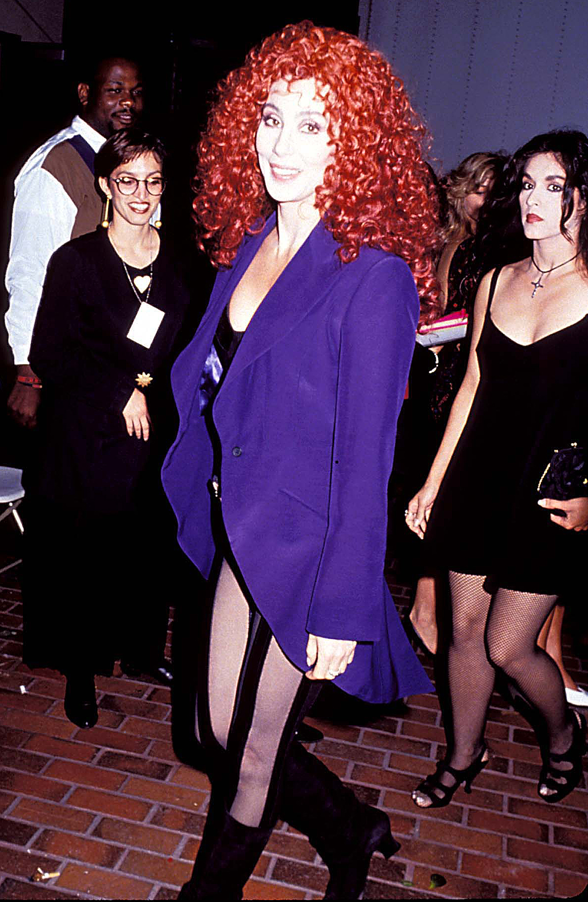 1991-Cher - Adhering to the playful dress code for the MTV Video Music Awards, the Mamma Mia! Here We Go Again actress changed up her classic long black hair with a curly red wig.