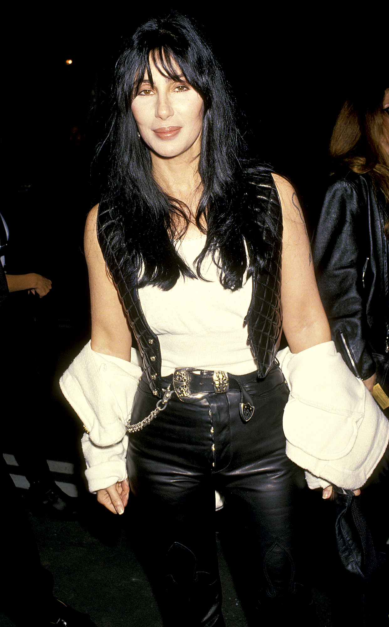 1994-cher - At the D.A.R.E. Benefit, Cher looked cool in black leather pants and a matching vest with a white tee and jacket.