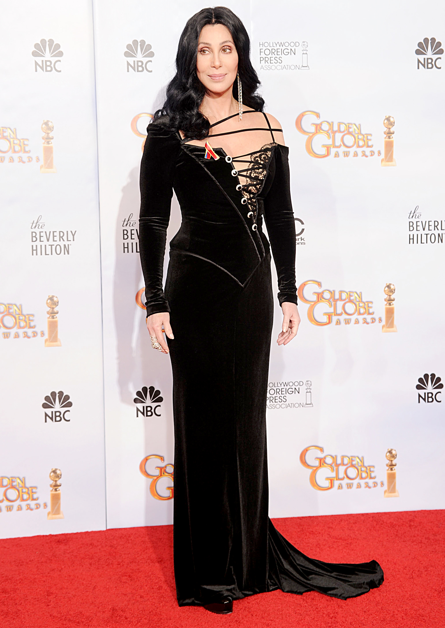 2010-Cher - At the 67th annual Golden Globes, Cher wore a black dress with corset-lacing asymmetrically up one side of the bodice.