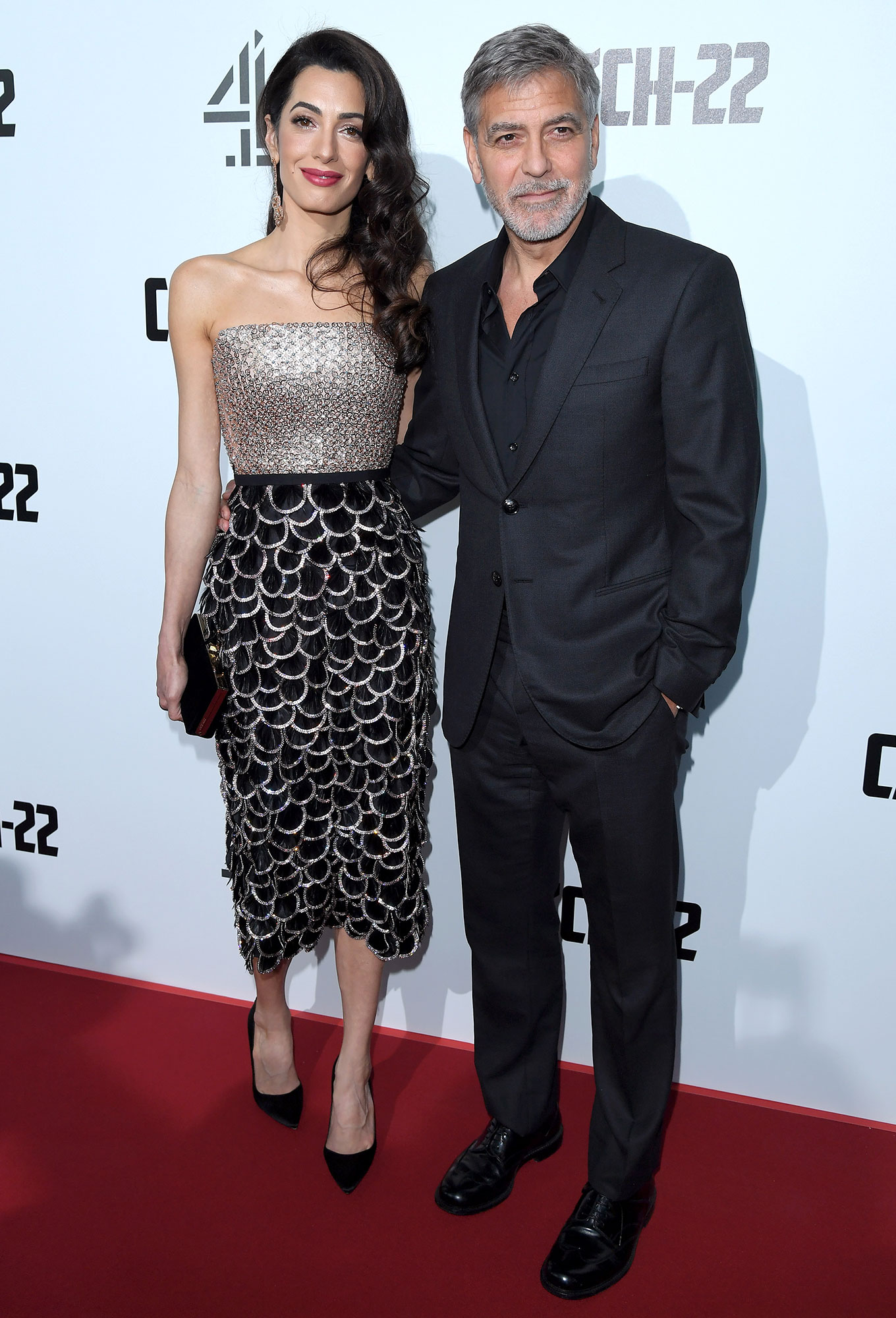 """Amal Clooney and George Clooney Sparkly Strapless Mididress - LONDON, ENGLAND – MAY 15: Amal Clooney and George Clooney attend the """"Catch 22"""" UK premiere at the Vue Westfield on May 15, 2019 in London, United Kingdom. (Photo by Karwai Tang/WireImage)"""