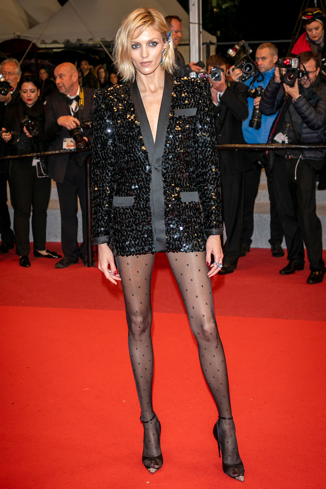 Anja Rubik Stepping Out in Style at Cannes Film Festival - Keeping things short and sweet, the model sparkled in a sequined Saint Laurent tuxedo-inspired minidress at the Lux Aetterna screening on Saturday, May 18.