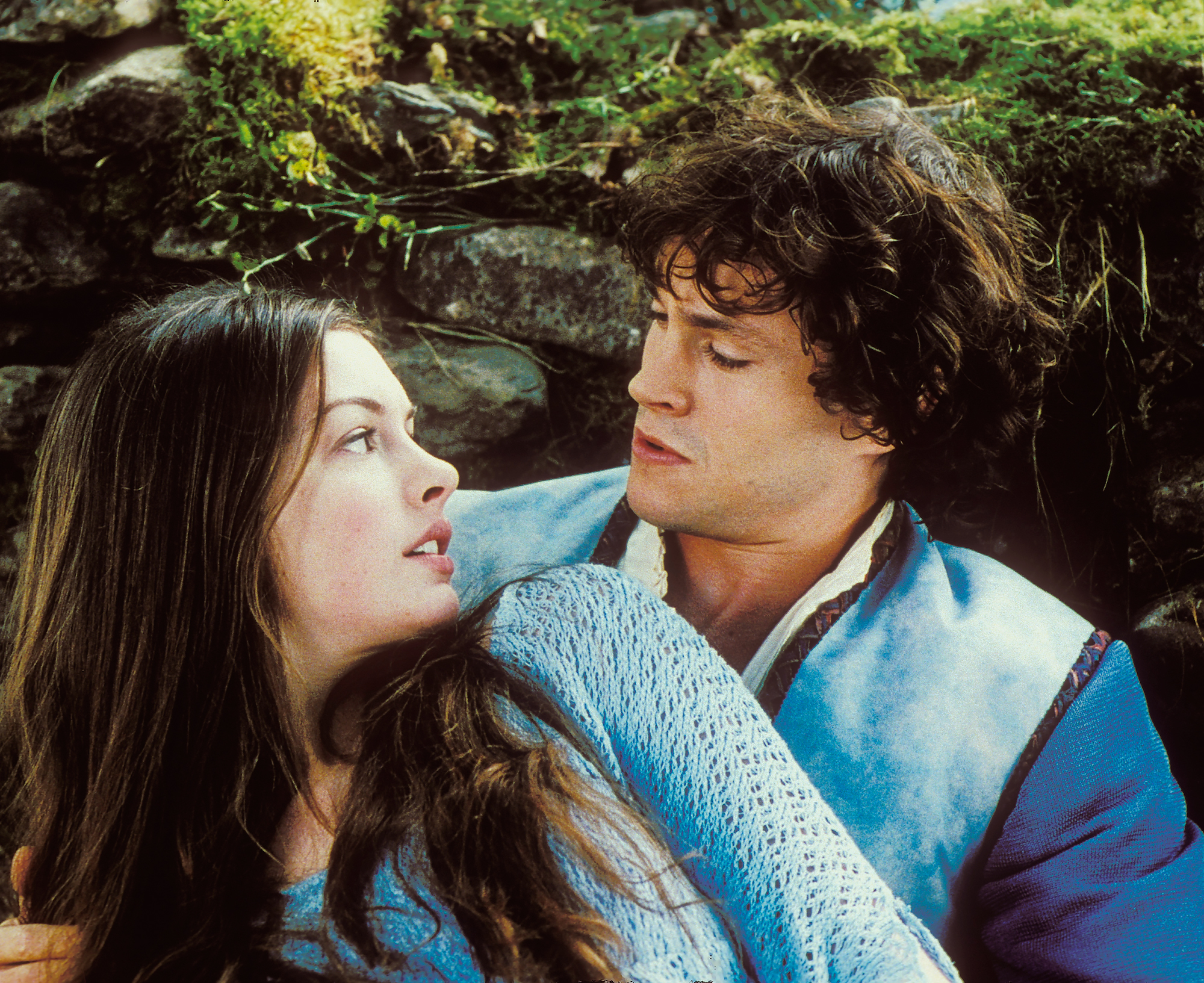 Anne-Hathaway-Hugh-Dancy-Ella-Enchanted - The Oscar winner got the chance to her royal skills from the Princess Diaries series in 2004's Ella Enchanted — another modern day take on (you guessed it!) Cinderella.