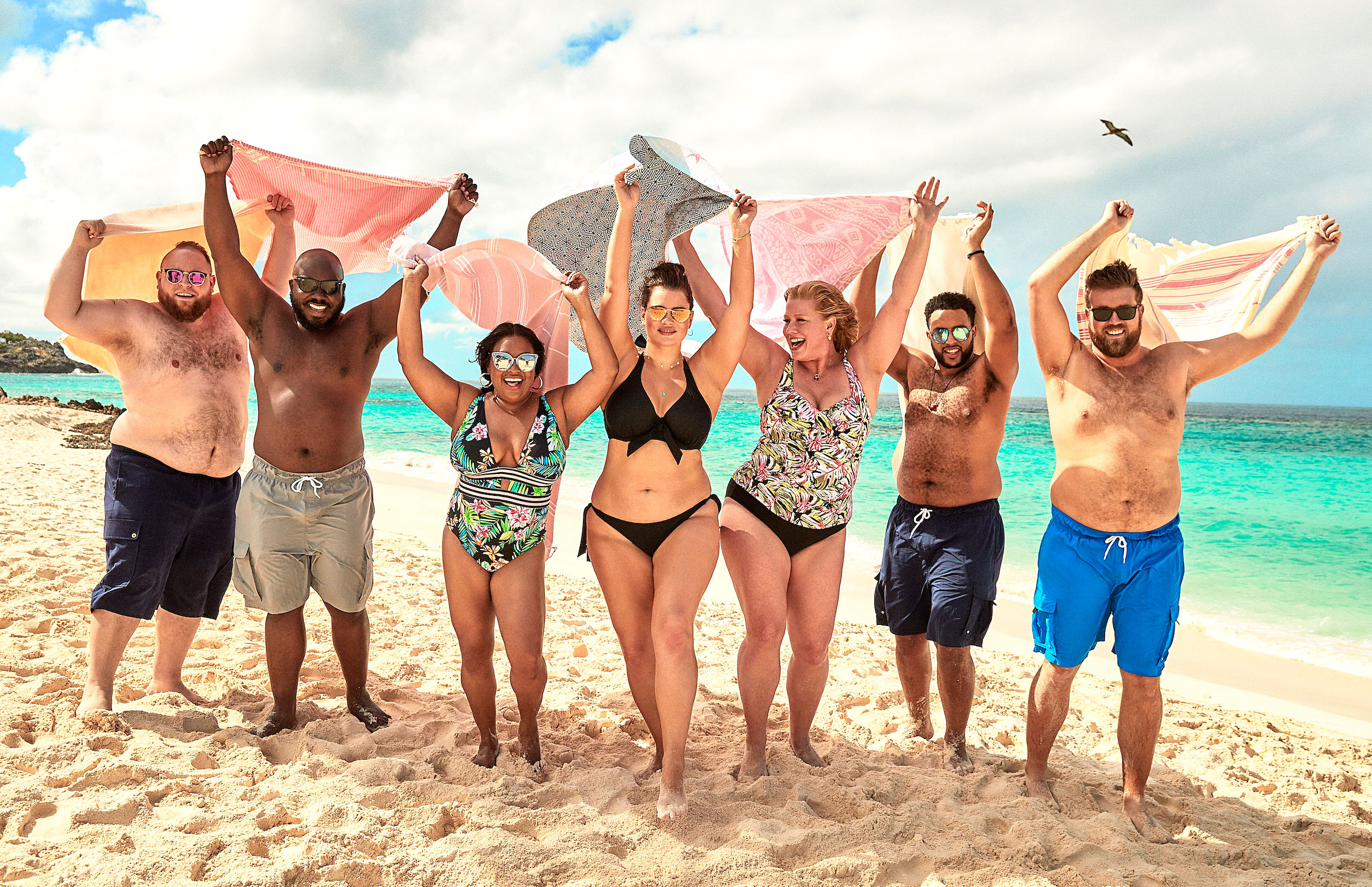 Ashley Graham Sherri Shepherd Lead Body-Positive Swim Campaign - The models look joyful as they throw their hands up in the air.