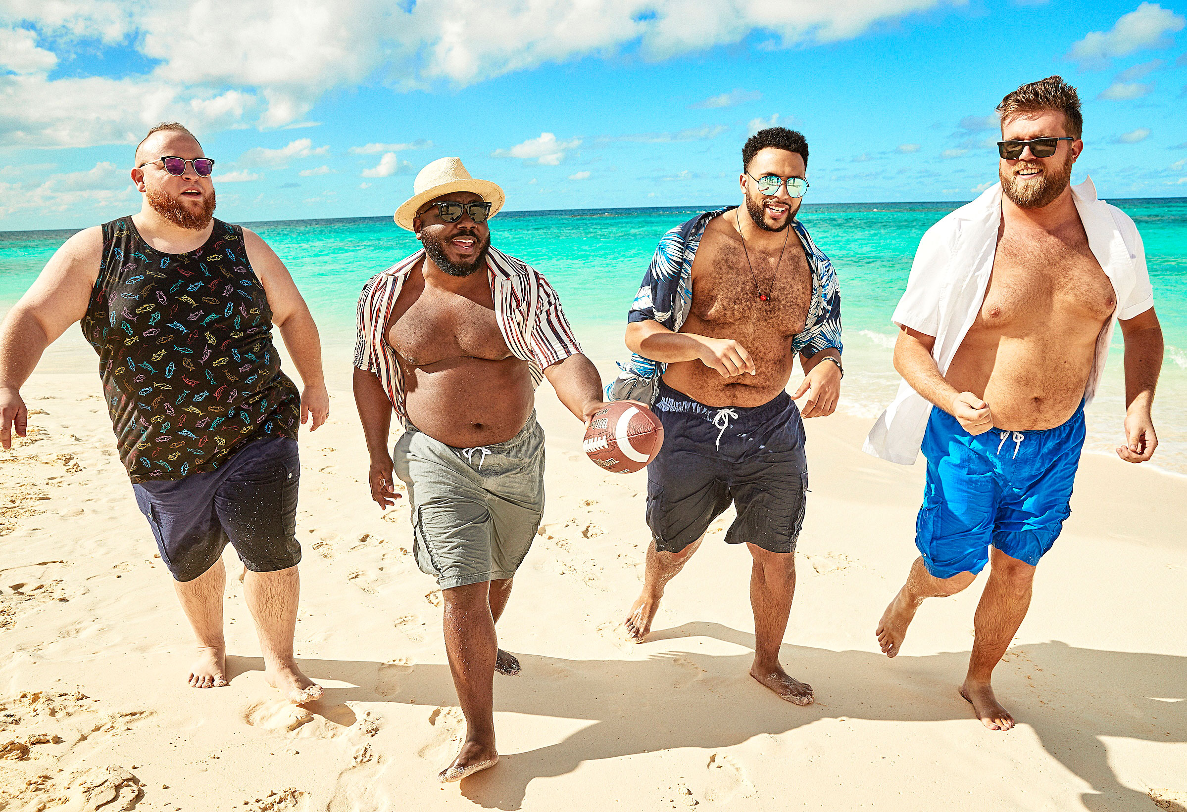 Ashley Graham Sherri Shepherd Lead Body-Positive Swim Campaign - Bruce Sturgell, Kelvin Davis, Najee Fox and Zach Miko (from left) enjoy the sand in beach looks from big and tall brand KingSize.