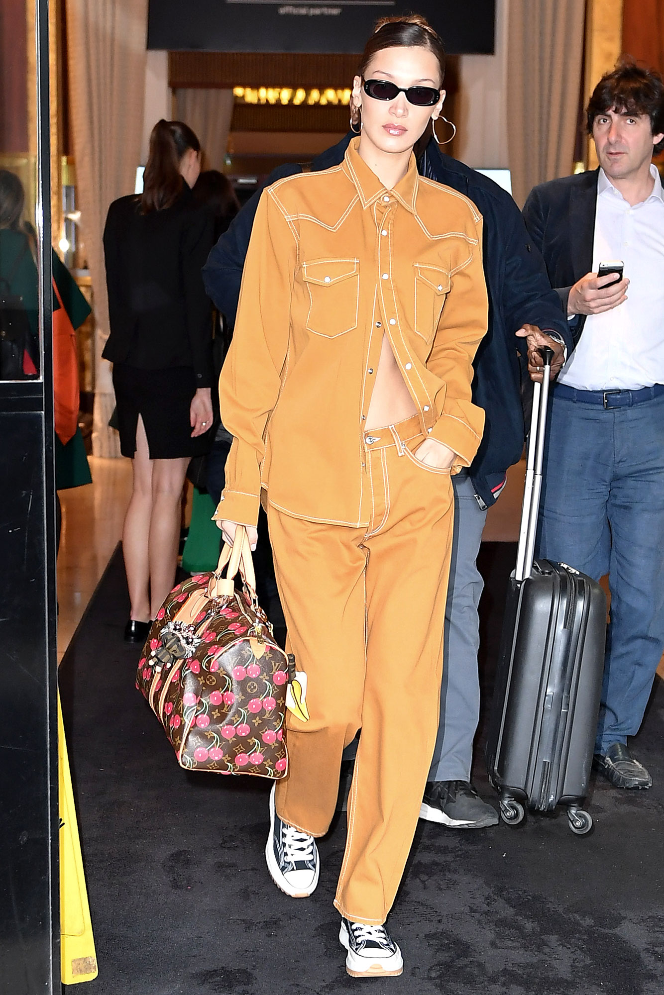 Stepping Out in Style at Cannes Film Festival - The model was seen departing her hotel on Saturday, May 18, in an ab-baring Sandro top and matching trousers. She accessorized with JW Anderson x Converse sneakers, Le Specs shades and a Louis Vuitton duffle.