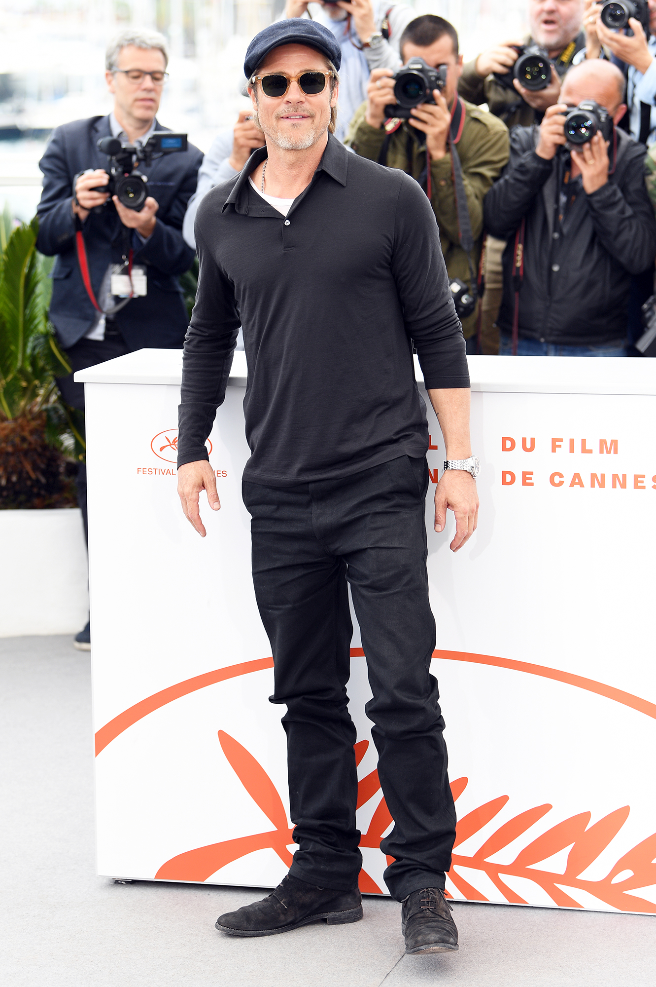 Brad Pitt - At the Once Upon a Time in Hollywood Cannes Film Festival photo-call on May 22, 2019, the actor kept things casual in a black polo, jeans and page boy cap.