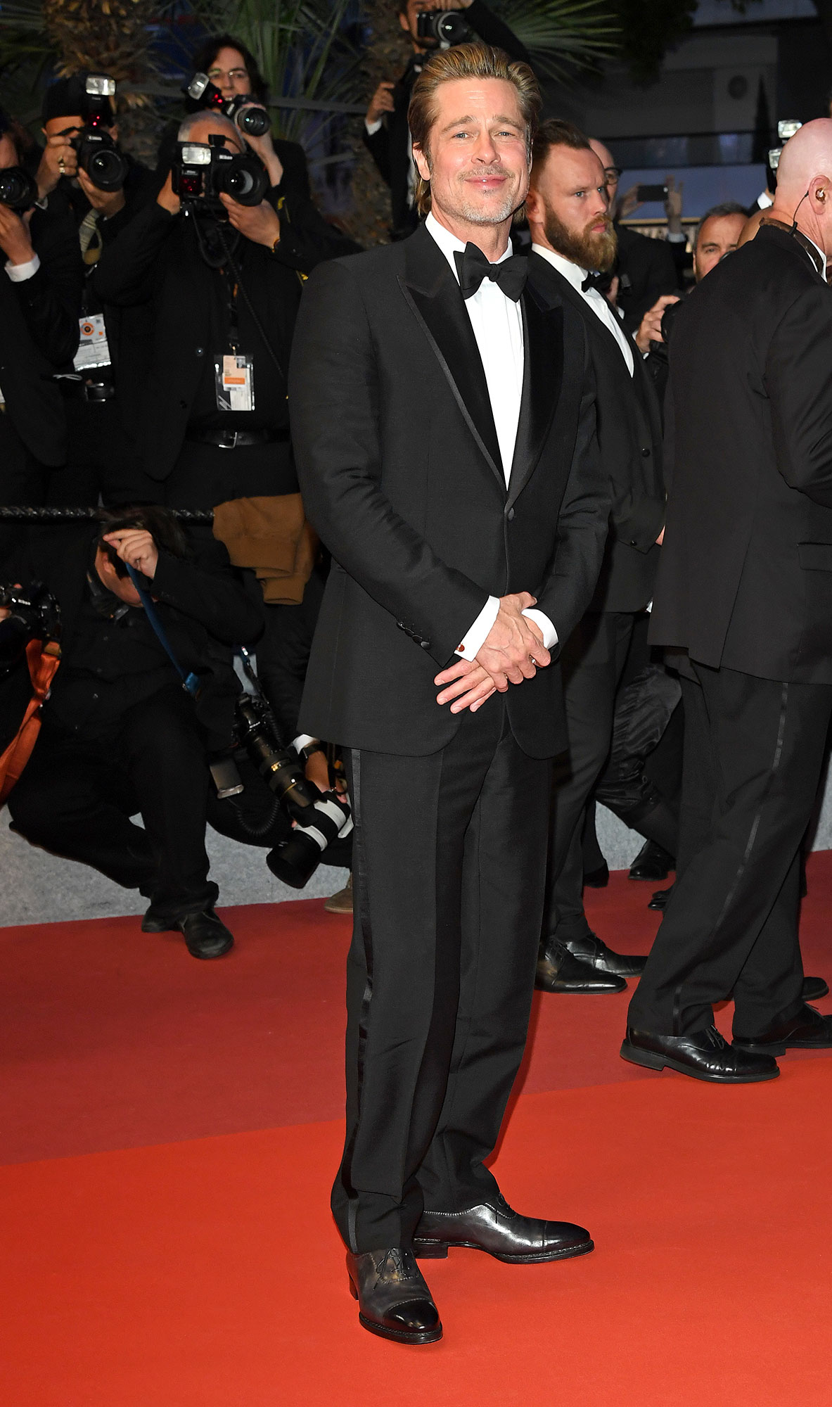 Brad Pitt Cannes Film Festival 2019 Most Stylish Guys Red Carpet - The Once Upon a Time in Hollywood star looked sharp in a black tux at the film's premiere on Tuesday, May 21.