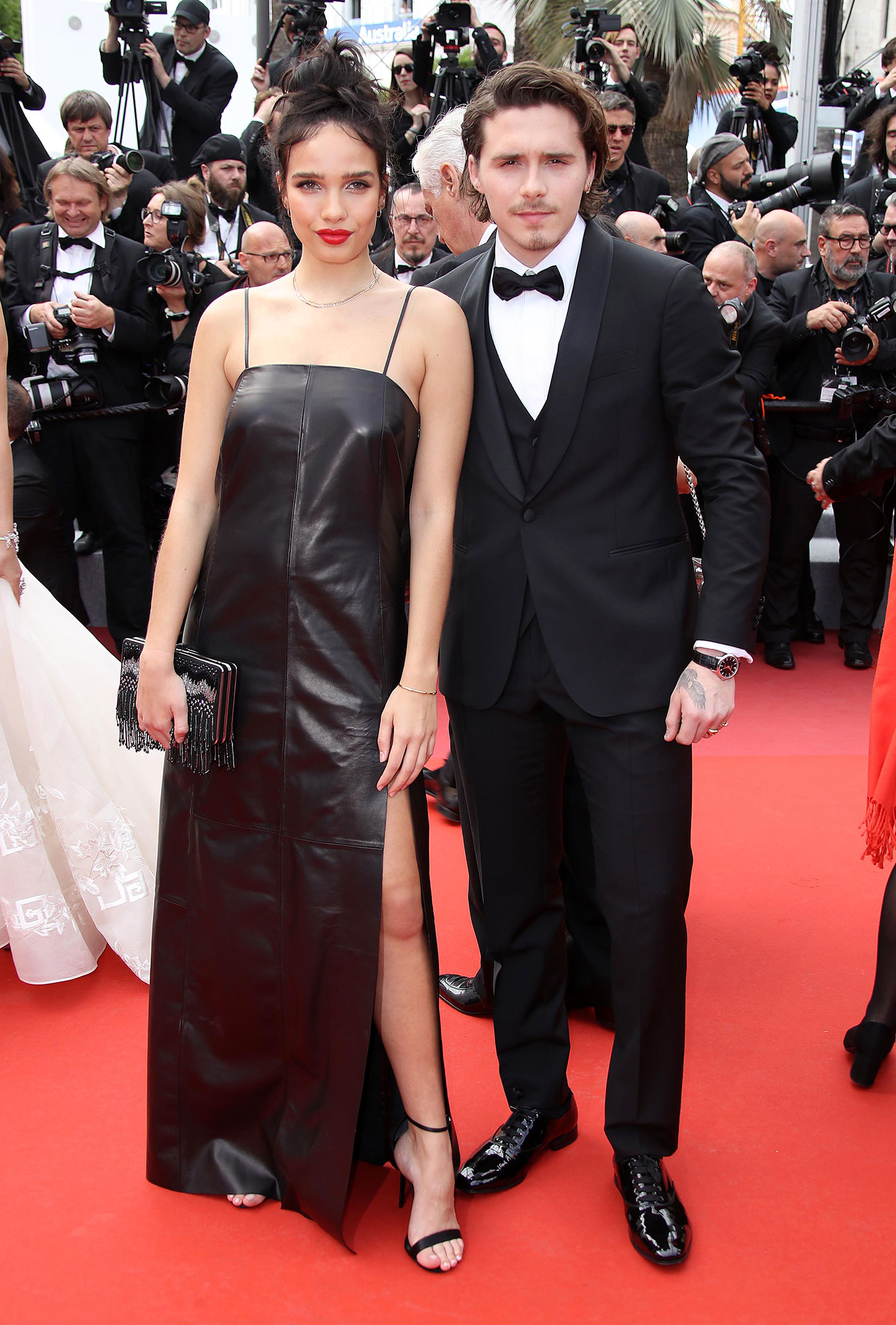 Brooklyn Beckham Cannes Film Festival 2019 Most Stylish Guys Red Carpet - David and Victoria's oldest son complemented his date, Hana Cross, in a black three-piece suit at the Once Upon a Time in Hollywood premiere on Tuesday, May 21.