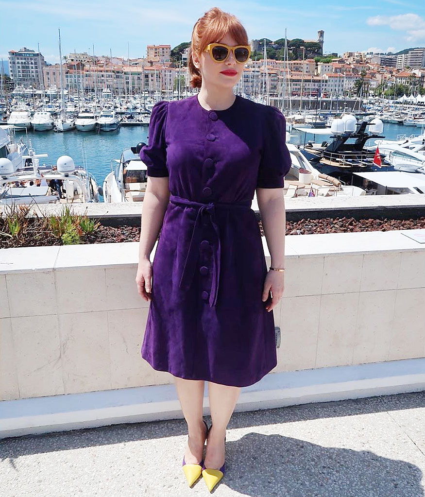 Bryce Dallas Howard Cannes Film Festival Real Real Consignment Purple Dress - At the Rocketman photo-call on Thursday, May 16, Howard chose a purple suede Ralph Lauren minidress, which she paired with color-block Manolo Blahnik pumps and yellow Smoke x Mirrors shades all found on The RealReal.